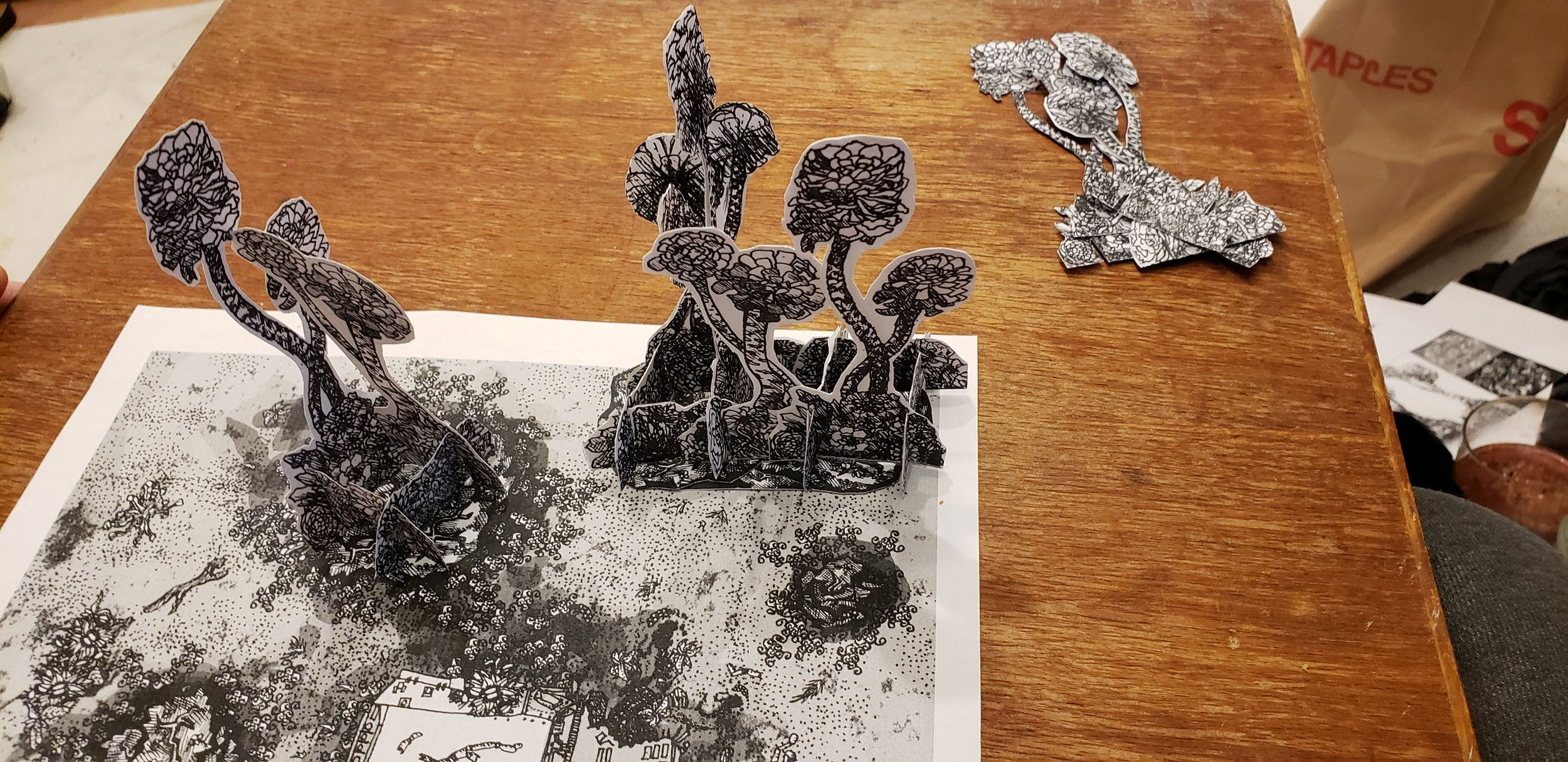 A few interlinked stands, atop a prototype map of the Forest of Woe, an infernal encounter space from Geoffrey Grabowski's  Dreams of Ruin  book.