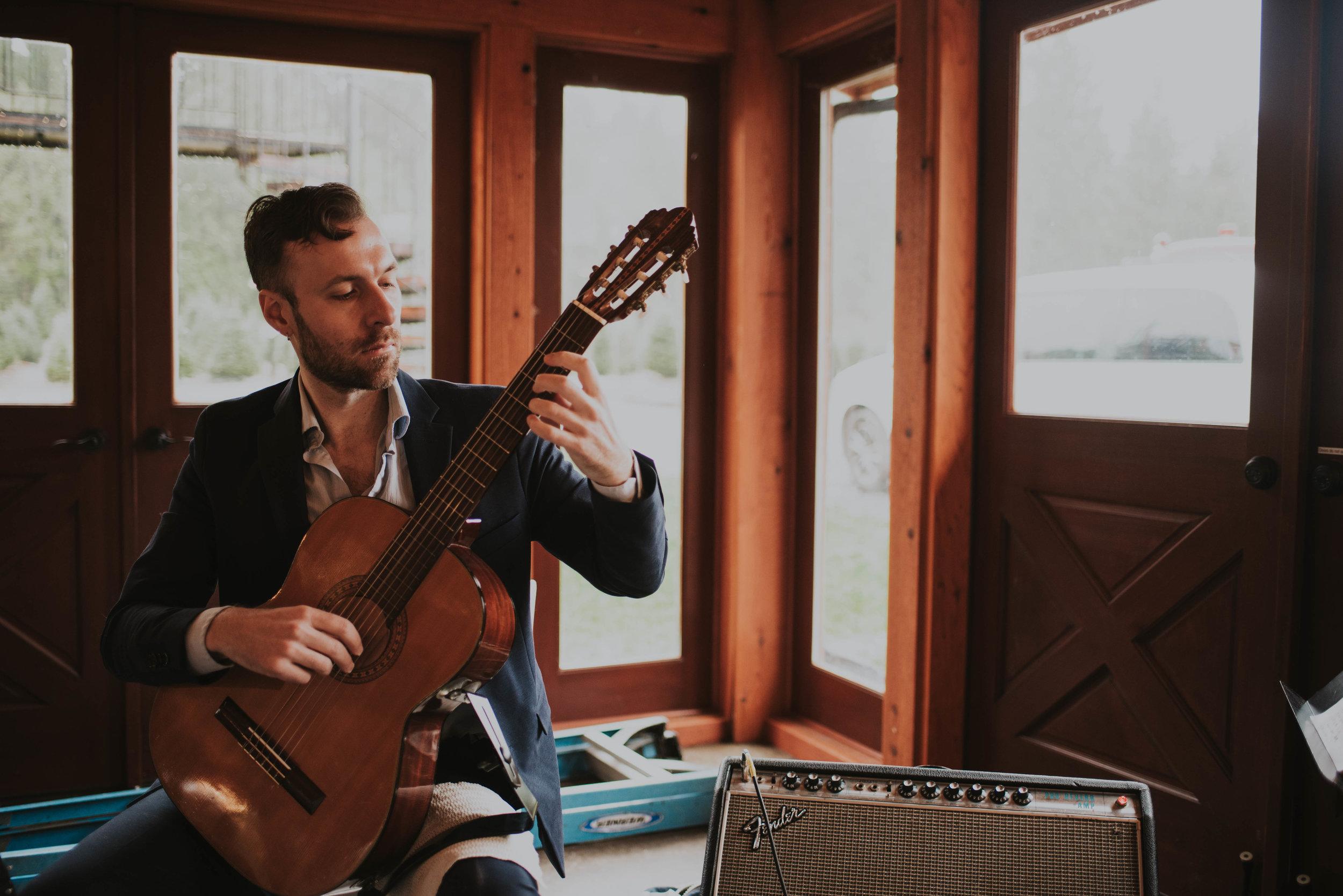 Jared Borkowski playing classical guitar