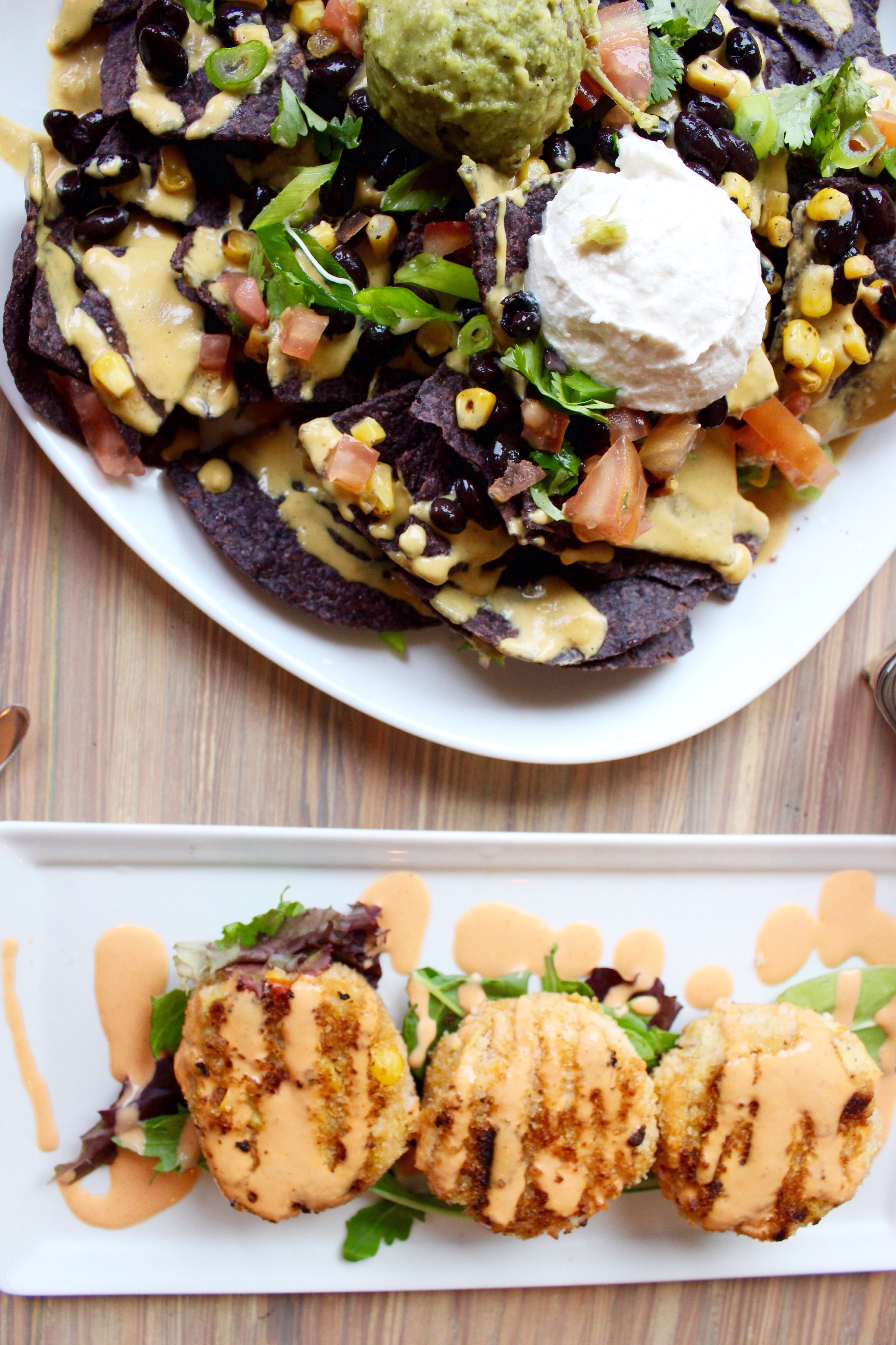 Seed nachos and artichoke cakes