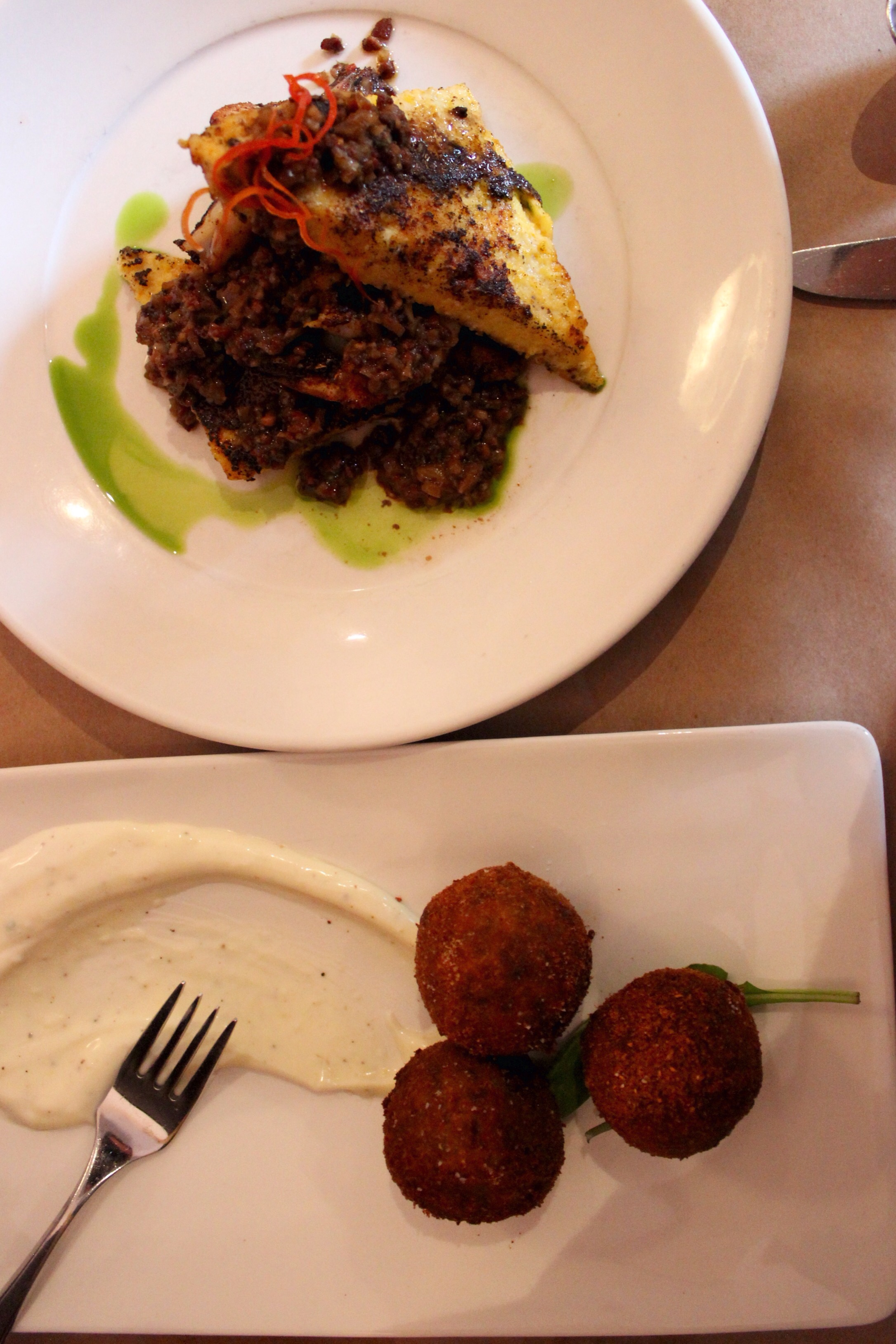 Boudin balls and blackened shrimp and grits