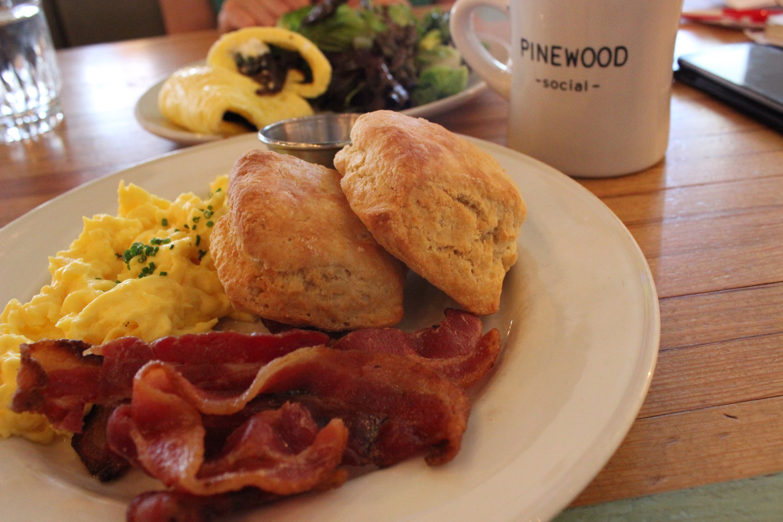 Went back for breakfast at pinewood social ... Biscuits and bacon .
