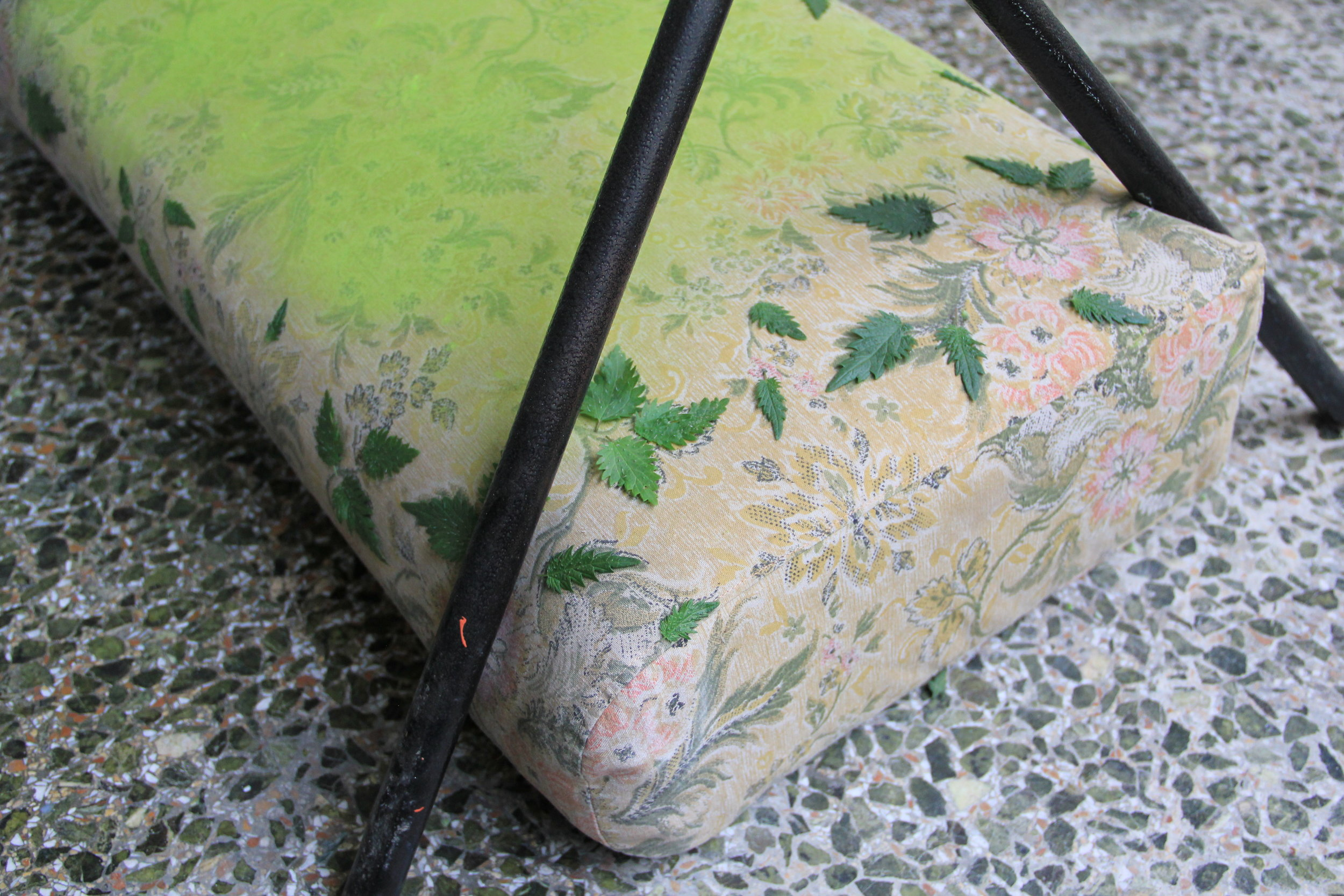 Detail: Leaves of roman nettles on manufactured cushion, spray paint, barbecue metal structure