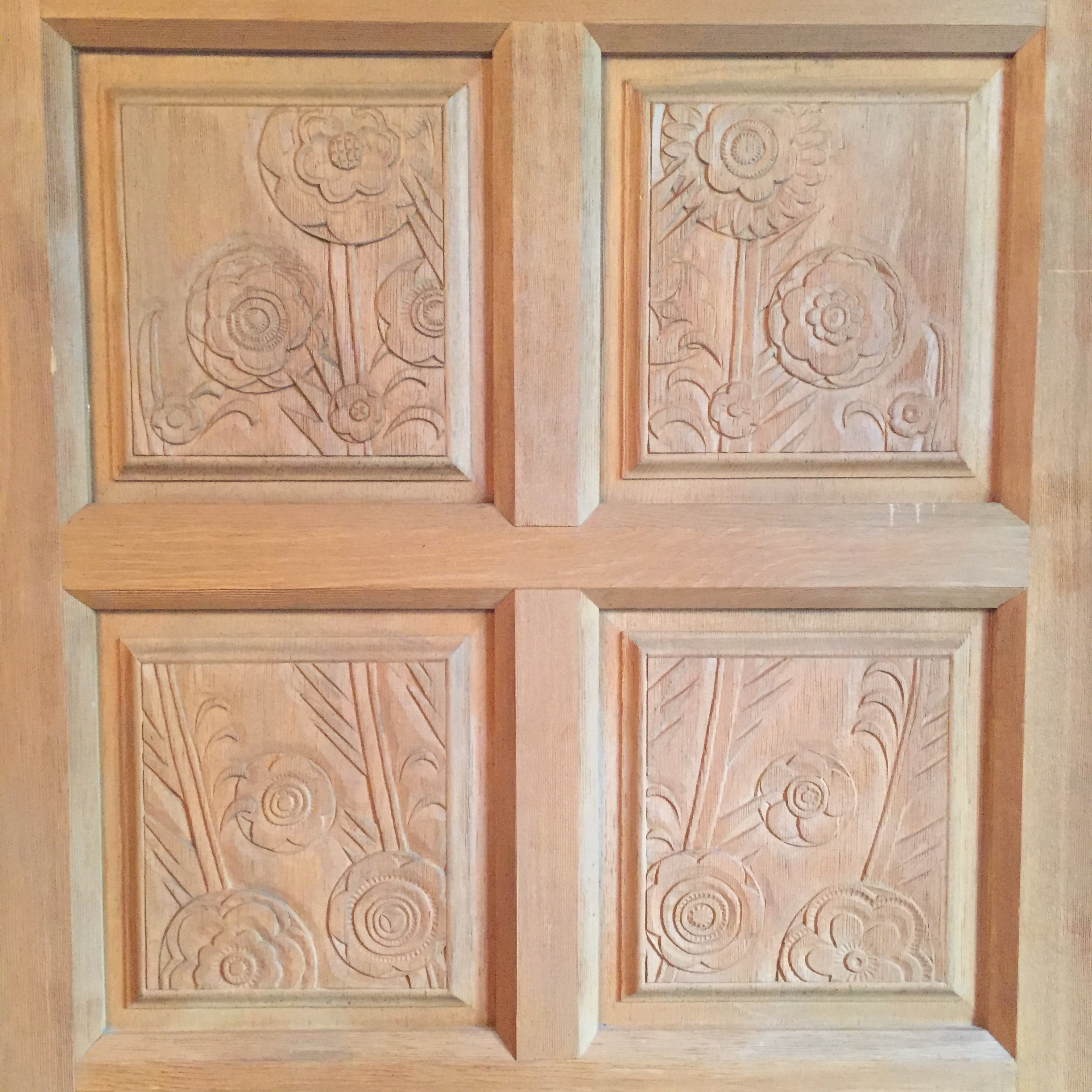 A carved wood detailing on one of the many hand-crafted antique doors on the property.