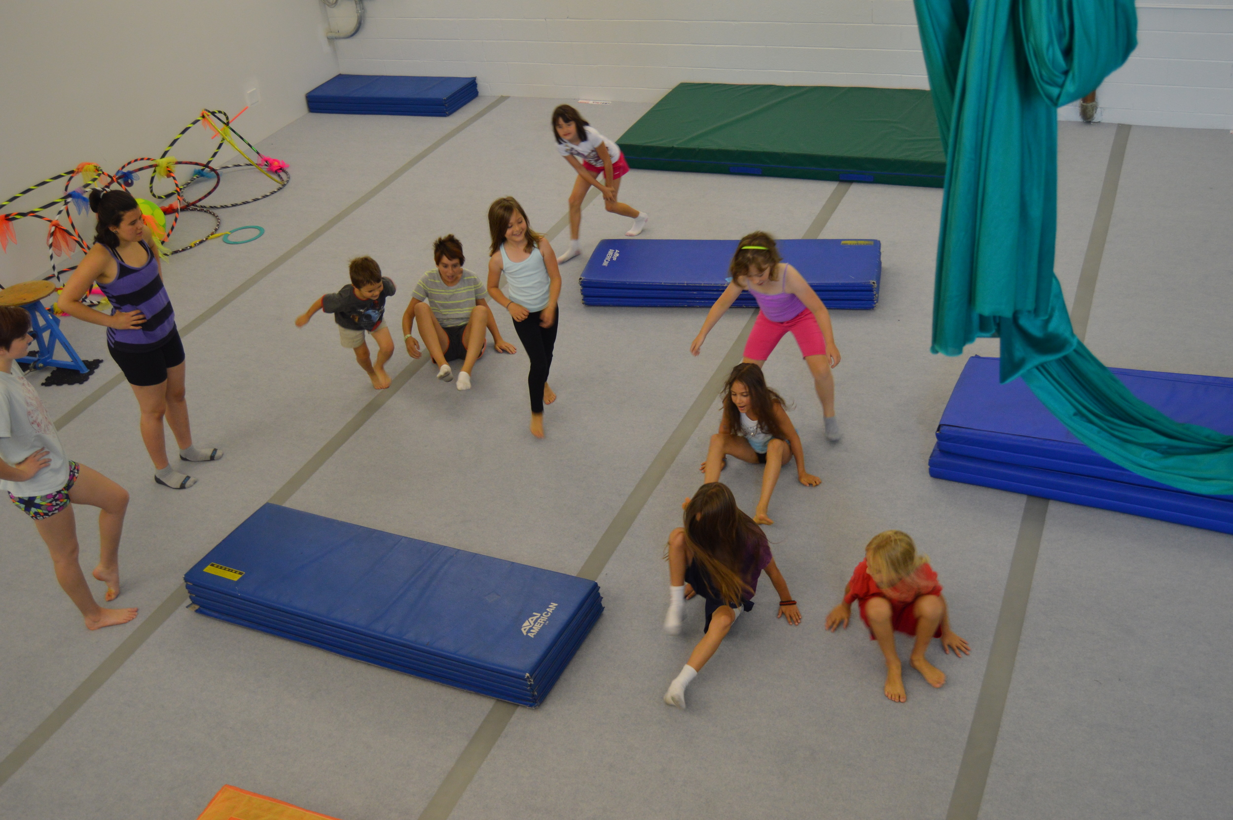 Come check out our awesome space - fully equipped with mats, aerial equipment, and circus props galore!