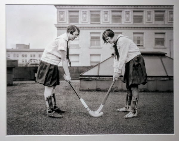 """When the Portland YWCA opened registration for spring sports classes in April 1927, Lillian Blackman and Sophia Wehrly posed for a photograph with field hockey equipment. Field hockey ""is not very well known generally,"" the Journal reported, noting that the YWCA would supply the equipment for the hockey class. ""It is a sport which provides vigorous exercise."" Blackman and Wehrly are on the roof of what is likely the YWCA building at SW Taylor and Broadway. Visible in the background is the Jackson Tower, where the Oregon Journal offices were located from 1912 to 1948. The YWCA building was demolished in 1959."""
