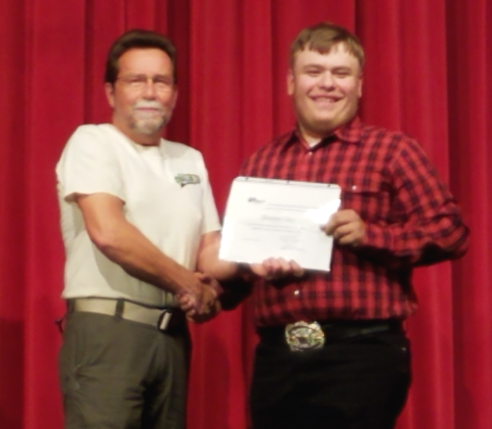 Scholarship being awarded on May 8th to Hunter Guy by Jef Jerde, Sparta Rod & Gun Club Secretary and Scholarship Committee Chairman