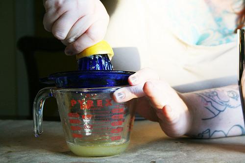 Juicing lemon. Sarah Palmer cocktail. Photo by Andrea Holodnick.