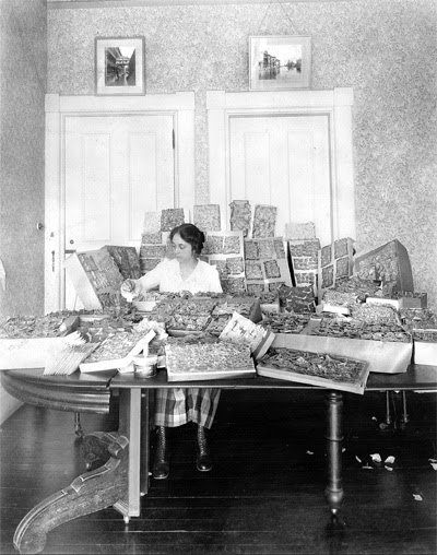 Opal Whiteley piecing together bits of her alleged diary, c. 1919. Via Moonshine Junkyard.
