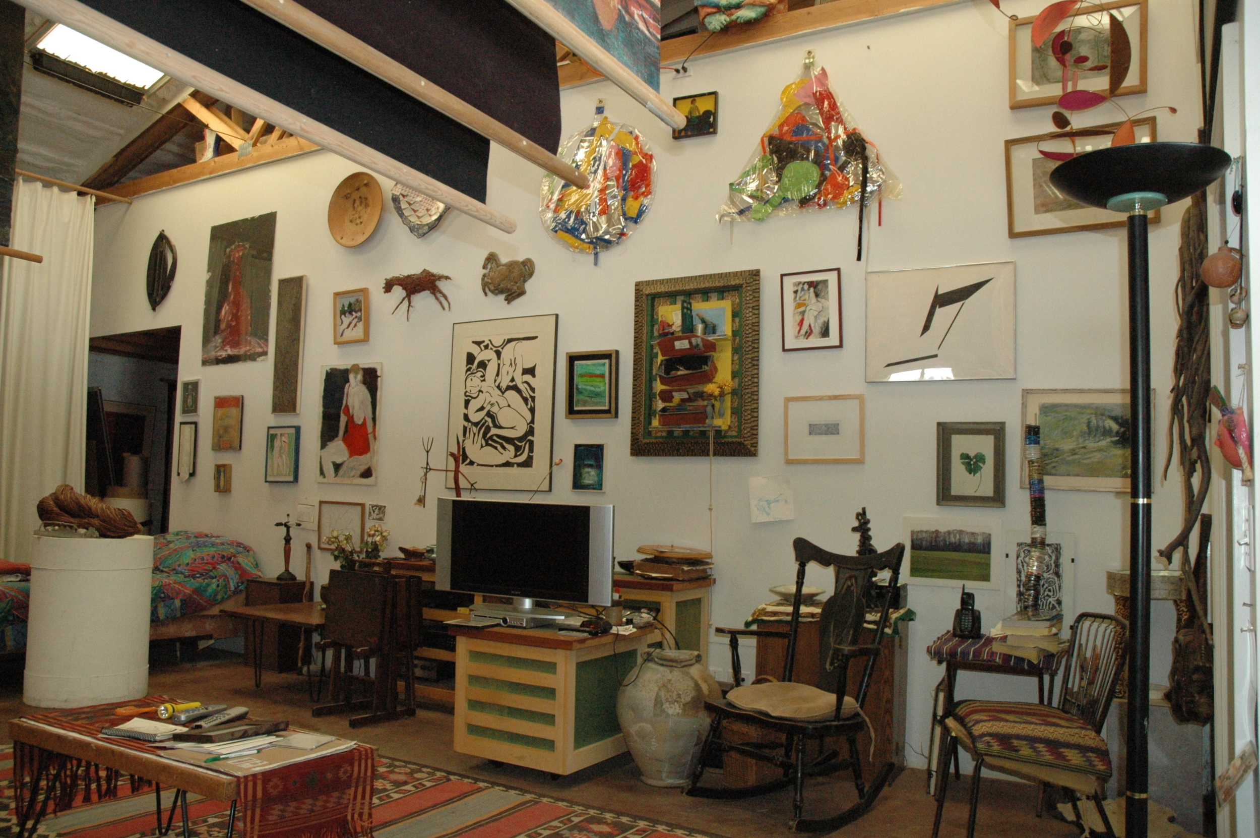 Gennie's studio wall, collection of friends.
