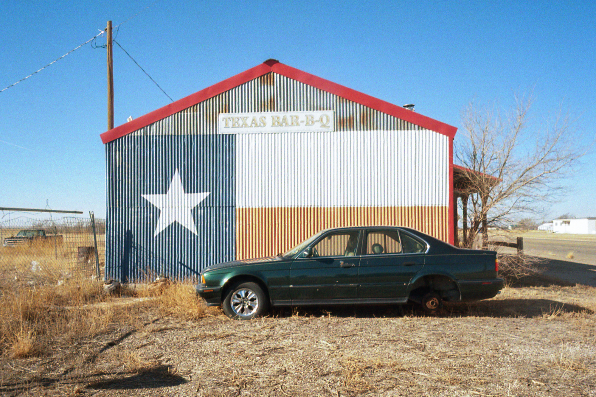 Abandoned car in a close down BBQ joint along the Route 66 in Texas - 2014