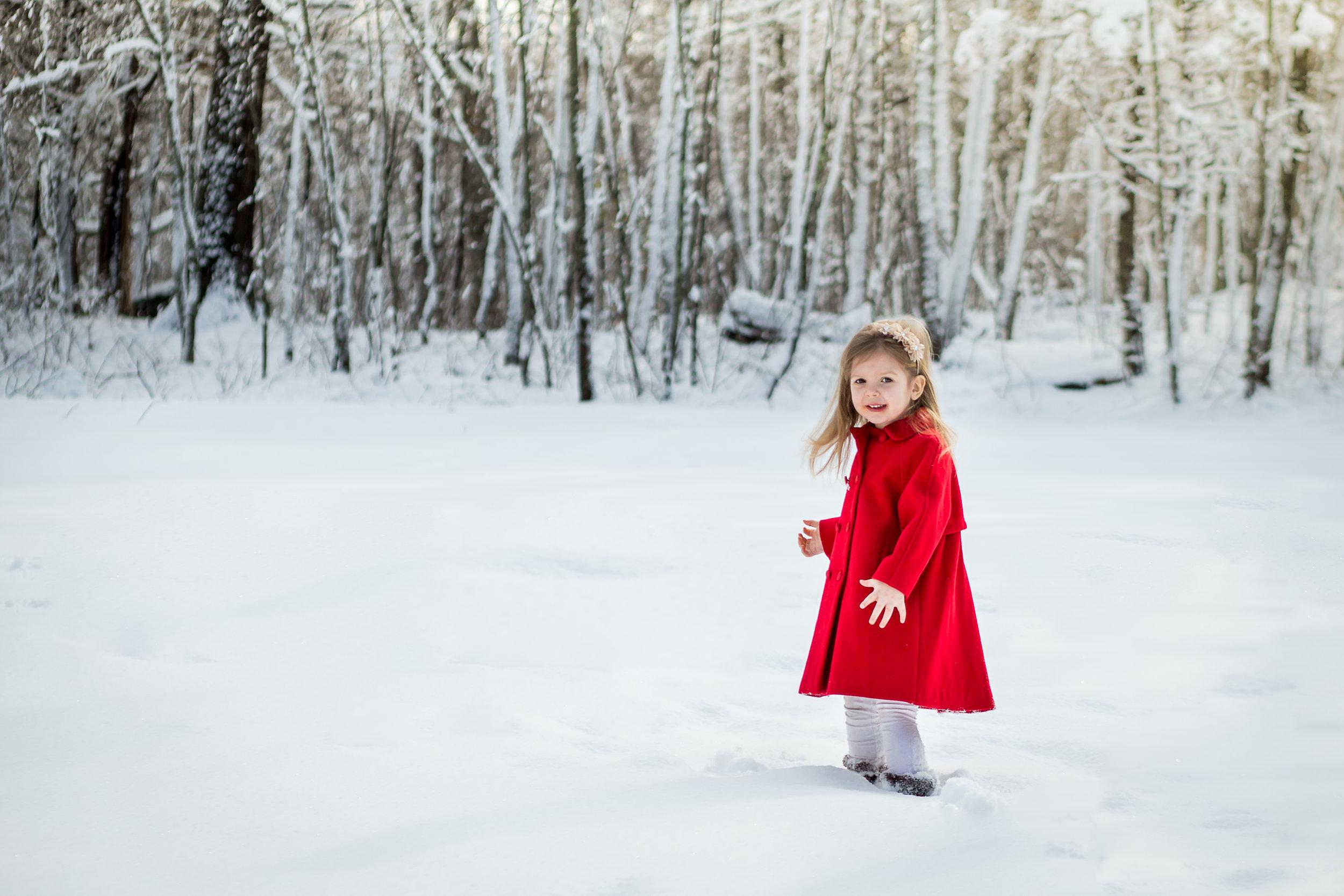 child-red-coat-snow-charlotte-photographer