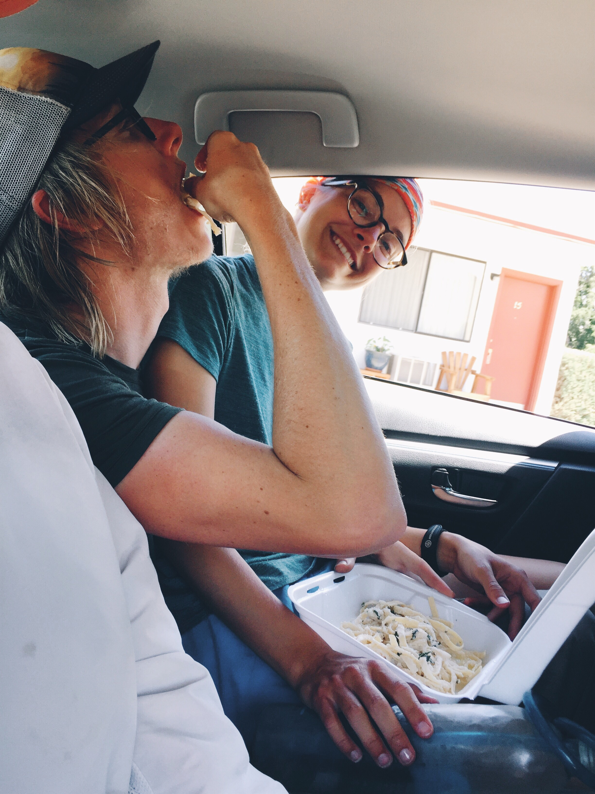 Eating leftover pasta in the car.
