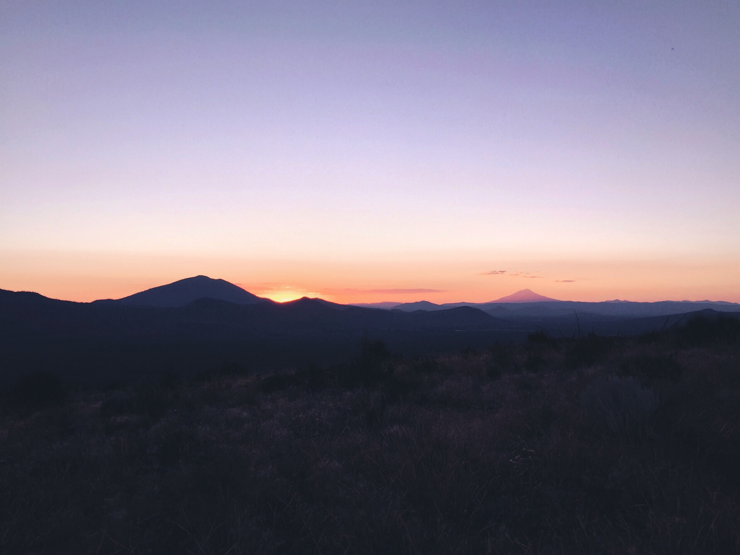 Sun setting with shasta in the distance.