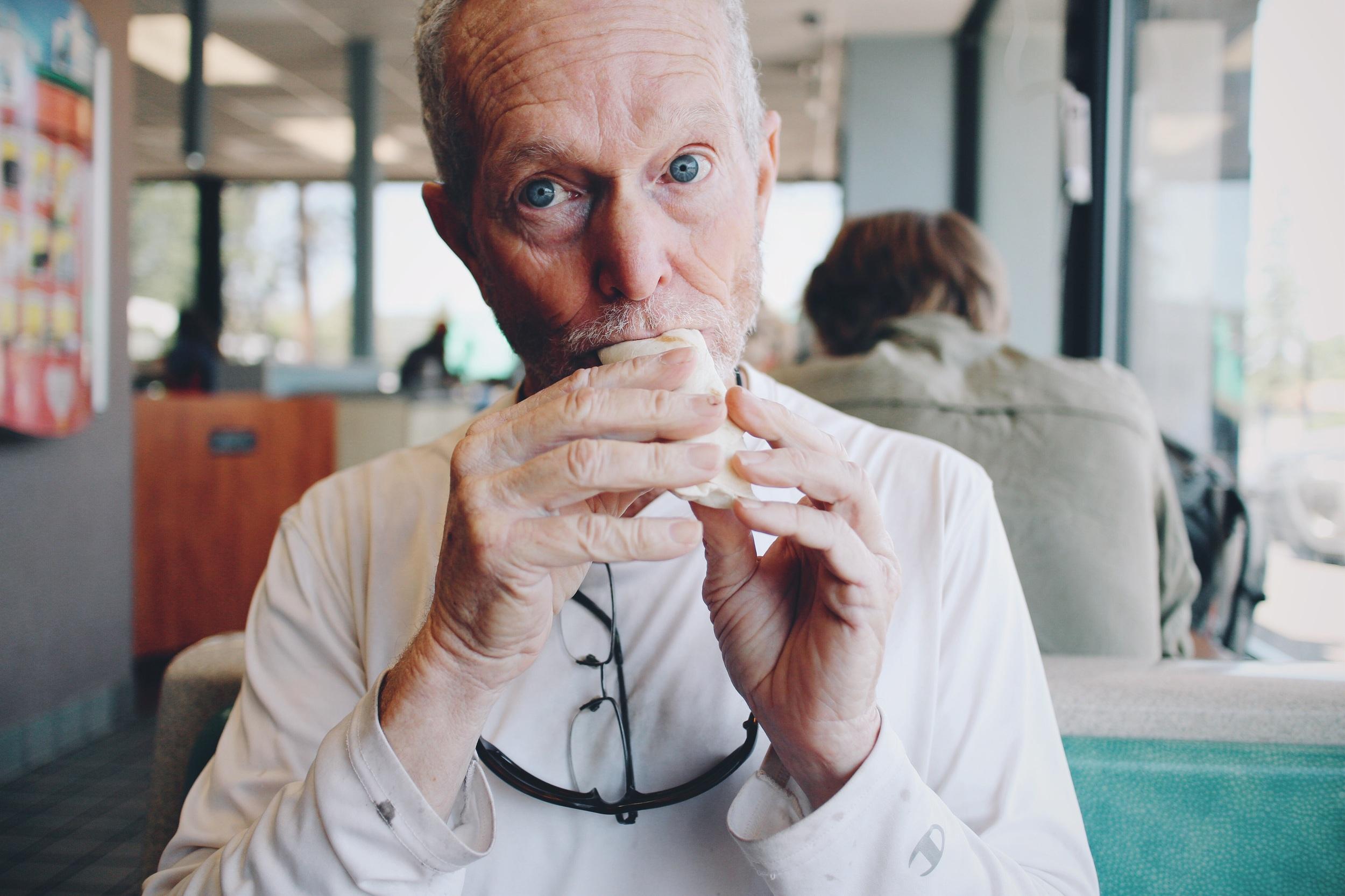 David eating his breakfast taco at McDs.