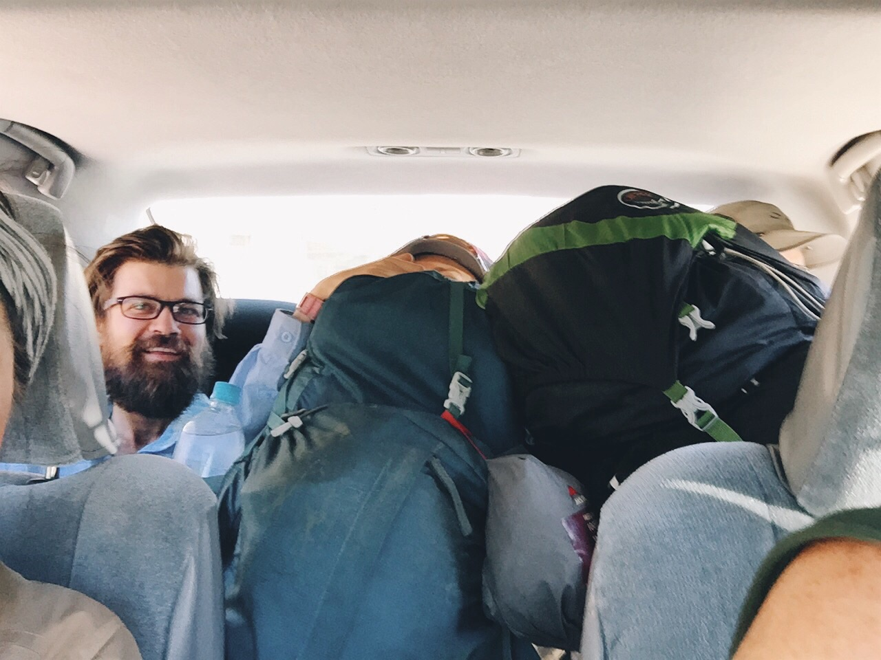 They all squished into the back of the car.
