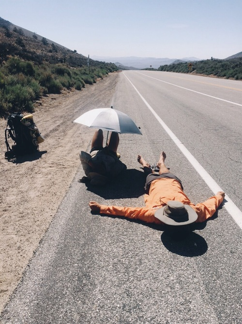 Laying on the hot, hot road, feeling helpless.