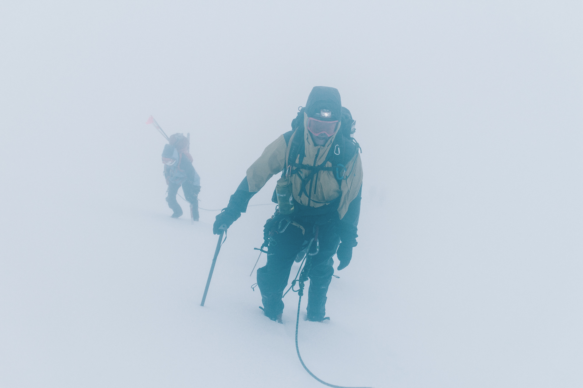Then we climbed in the whiteout for several hours with freezing rain blowing at us all morning, completely soaked from head to toe.