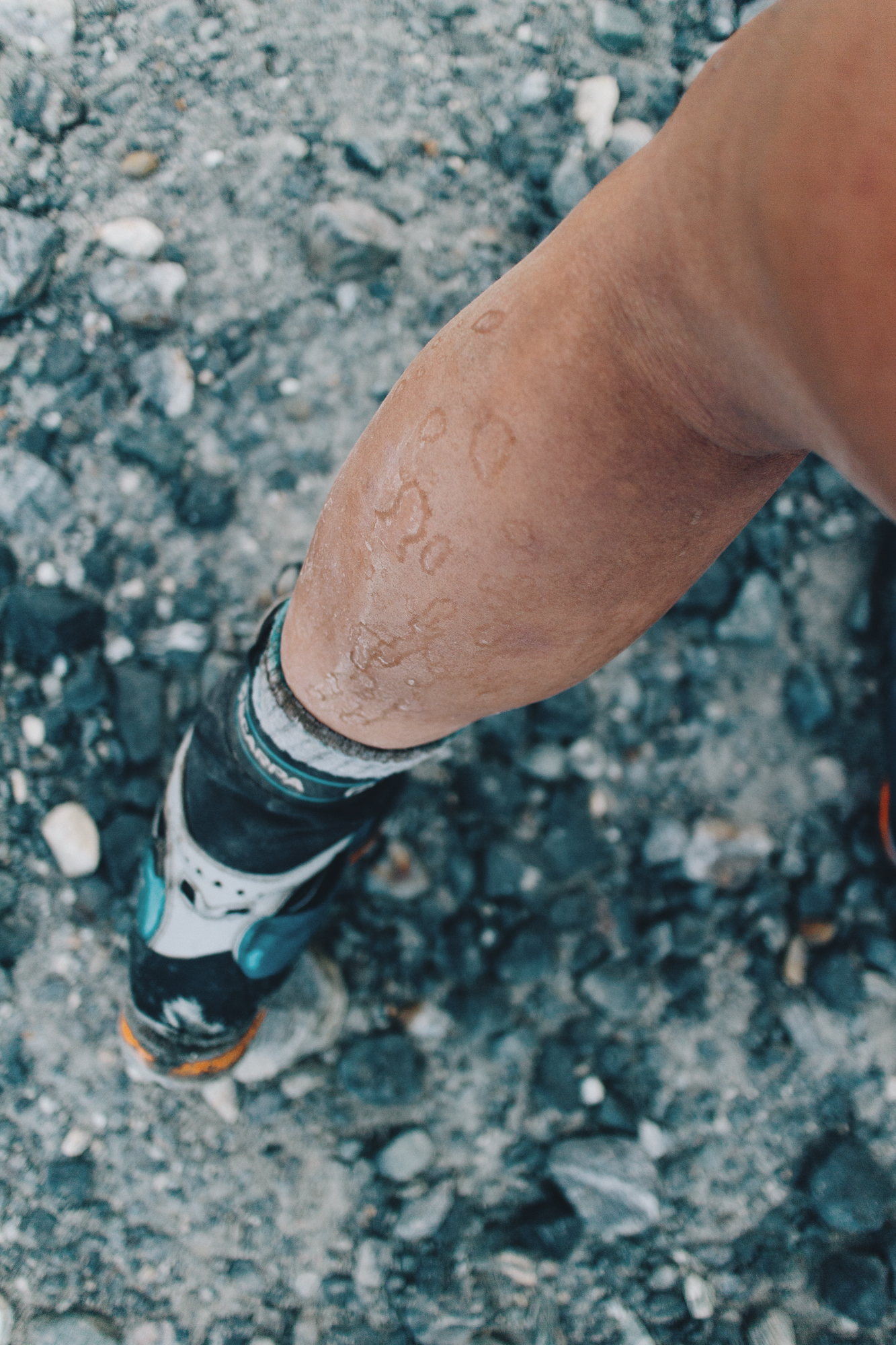 I reached the summit in shorts and so much dirt, silt and snow were glued to my legs.