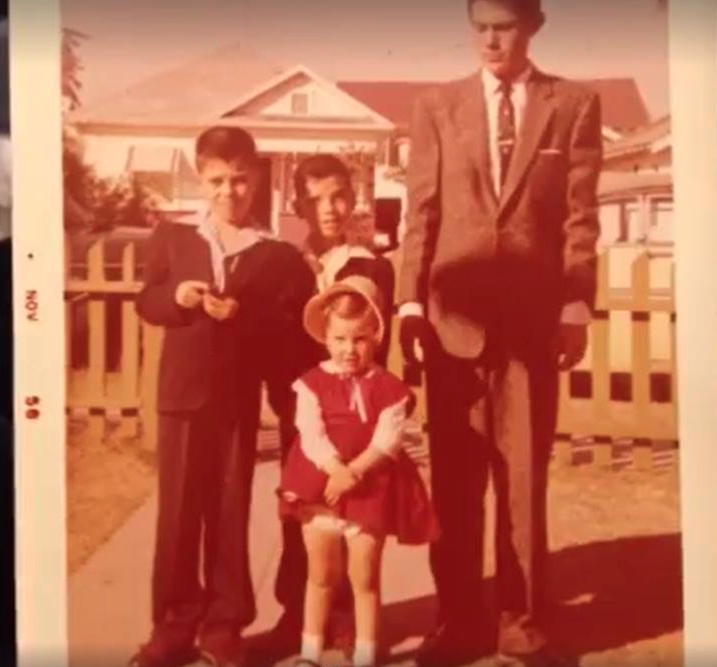 My dad is that little one in the middle with the cool guy eyebrow thing going on