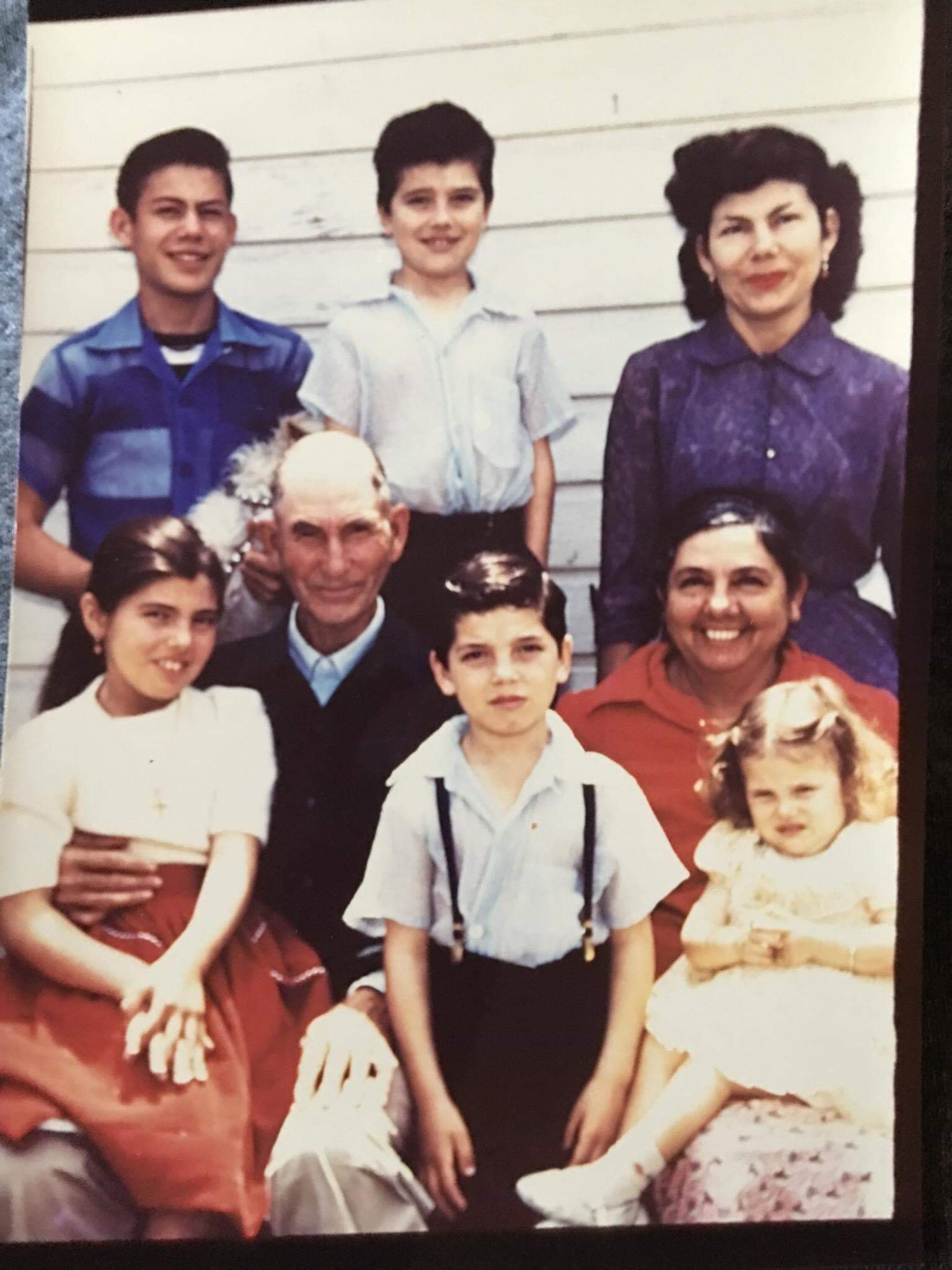 My father's unenthused face looks exactly the same now as it did when he wore suspenders. Mid-1950s