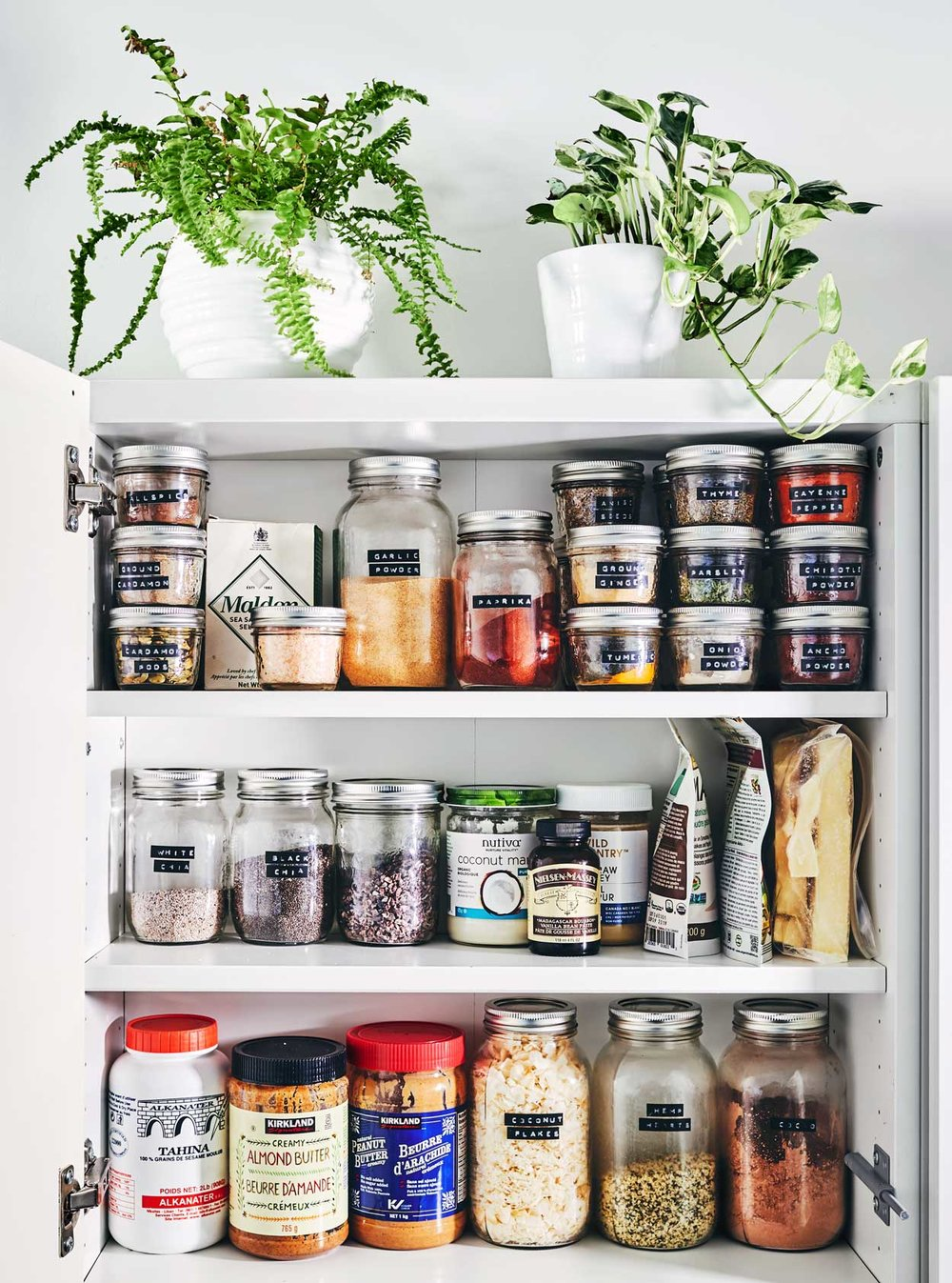 Our Pantry - The key to a healthy, inspired kitchen is an organized one. While your pantry doesn't need to be fully-stocked at all times, having a reliable set of go-to ingredients will allow you to quickly throw a meal together. Say hello to stress-free meals at home, and goodbye to sad, overpriced takeout.We've written up all the behind-the-scenes of what we stock in our pantry, tips on how to buy/prepare them, and specific brands we'd recommend.Check out all the details here→
