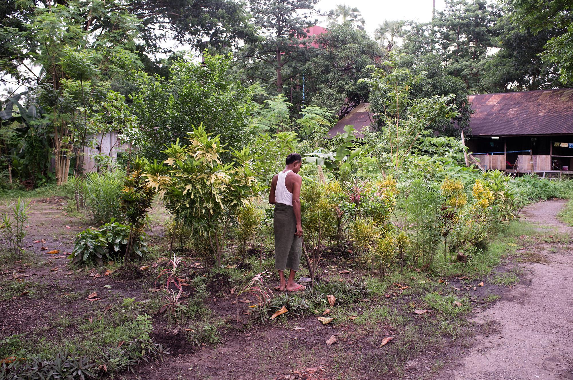 Tending to his garden.