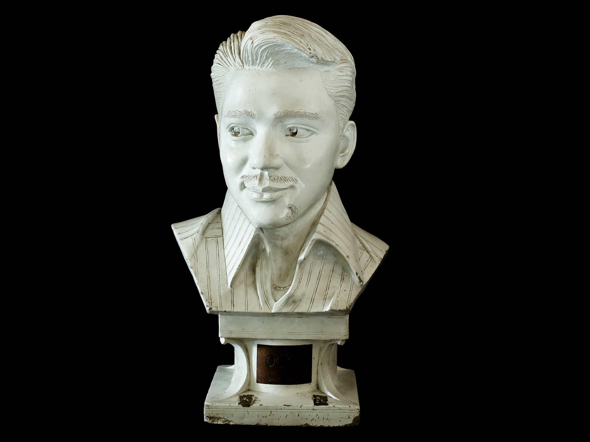 A bust of Burma's most famous actor, Win Oo. Born in Yangon in 1935, he won numerous academy awards for his performances, including Best Actor for  Hmon Shwe Yee  in 1970. He starred in 27 films, before passing away in 1988.