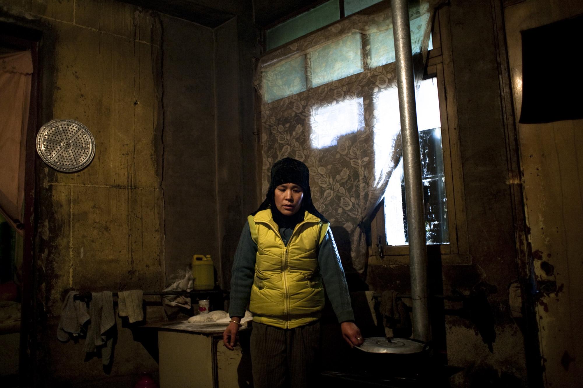 Ma Lan Hu in her kitchen.