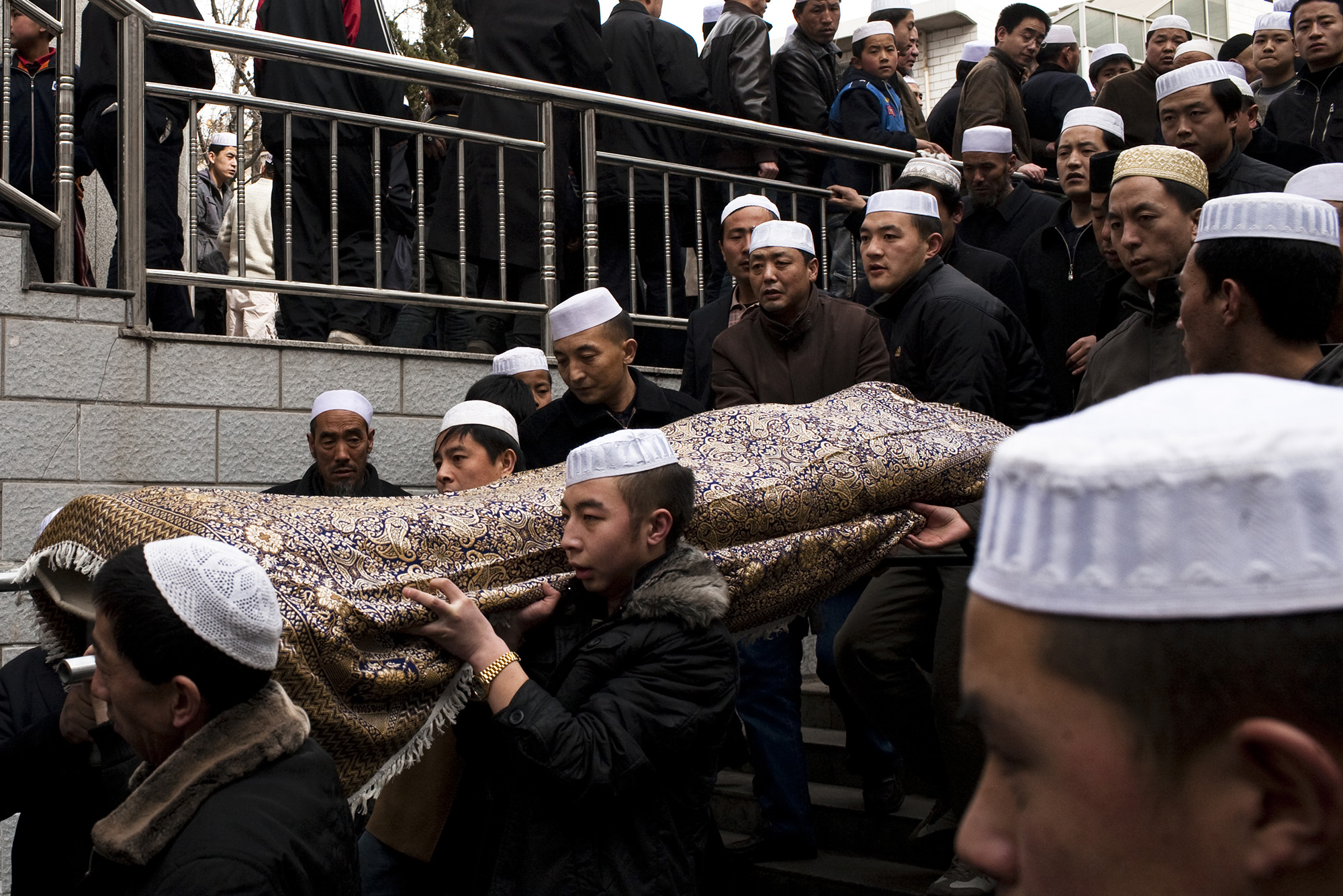 A funeral takes place at a neighbouring mosque.
