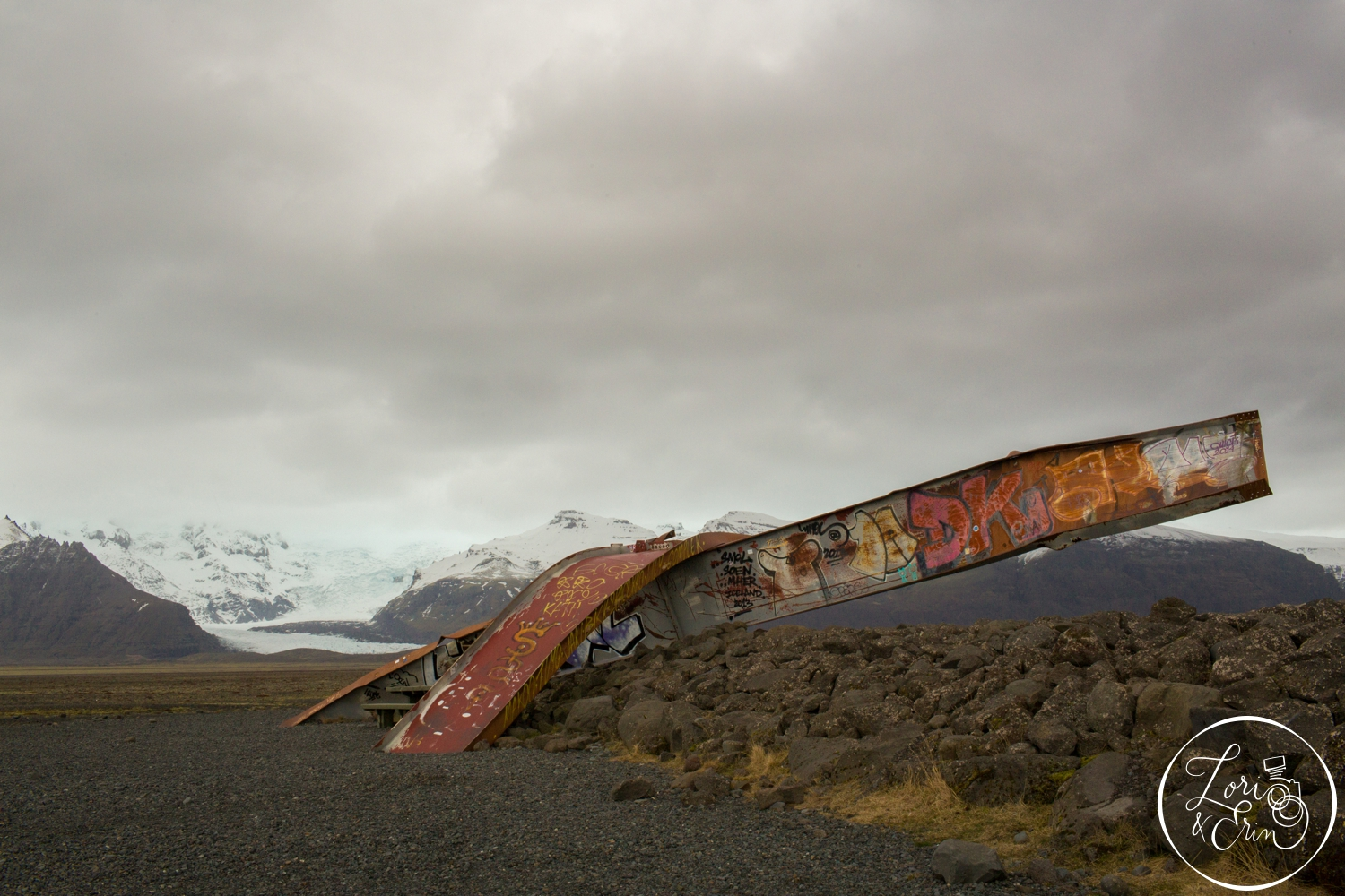 Remnants of a bridge with a glacier in the background