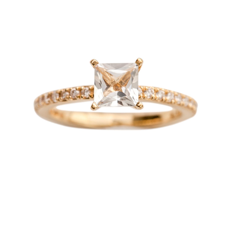 FIRENZE ENGAGEMENT RING -  21.200 NOK. 18 ct yellow gold. 1 ct white topaz, 0,24 ct diamonds.