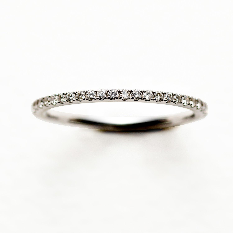 PETIT OLIVIA WEDDING RING - 17.500 NOK. 18 ct white gold .O,33 ct diamonds.