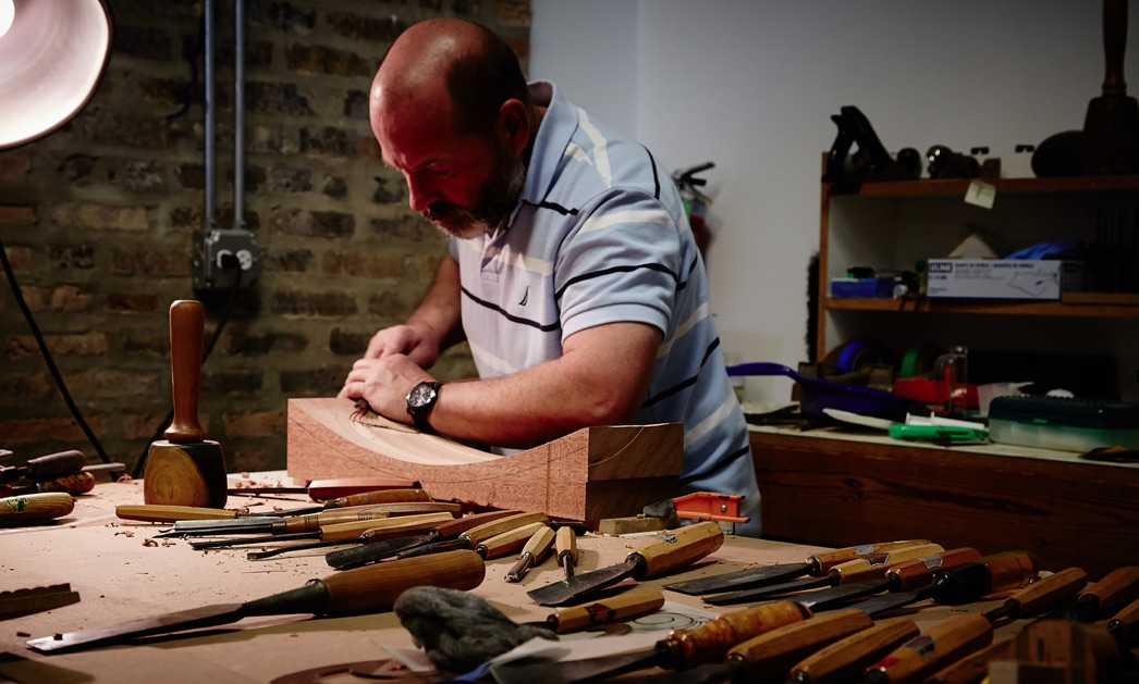 Senior Conservator Stephen Ryan carving a back split for a chair at The Center's Antique and Fine Furniture studio.