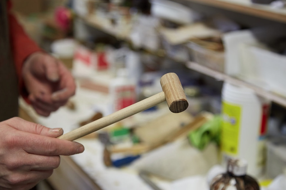 A soft hammer made in-house, used when a regular hammer would potentially dent or damage the surface. It's great for little brass pins and leather.