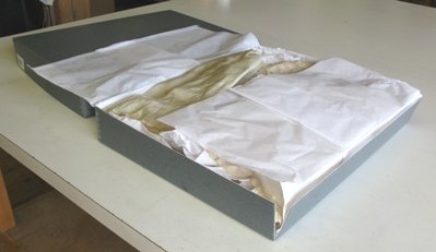 (Above) Example of long term archival materials: an acid-free, corrugated box with acid-free tissue.