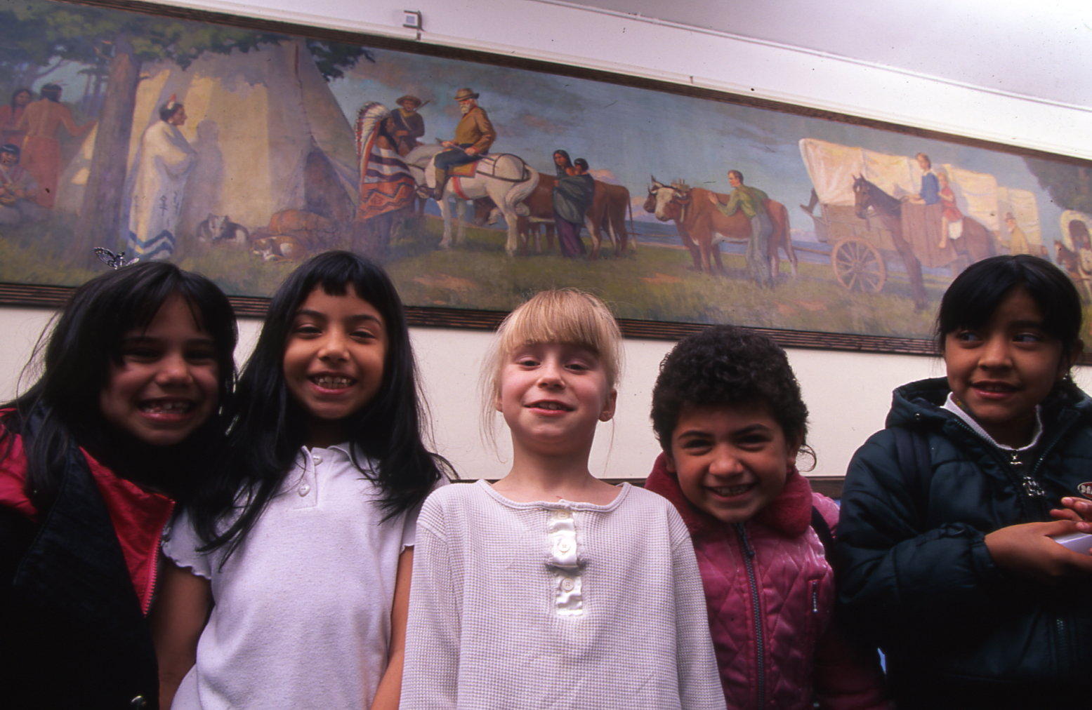 Pioneers and Indians , Datus E. Myers, 1920, oil on canvas, at Linné Elementary School with students.