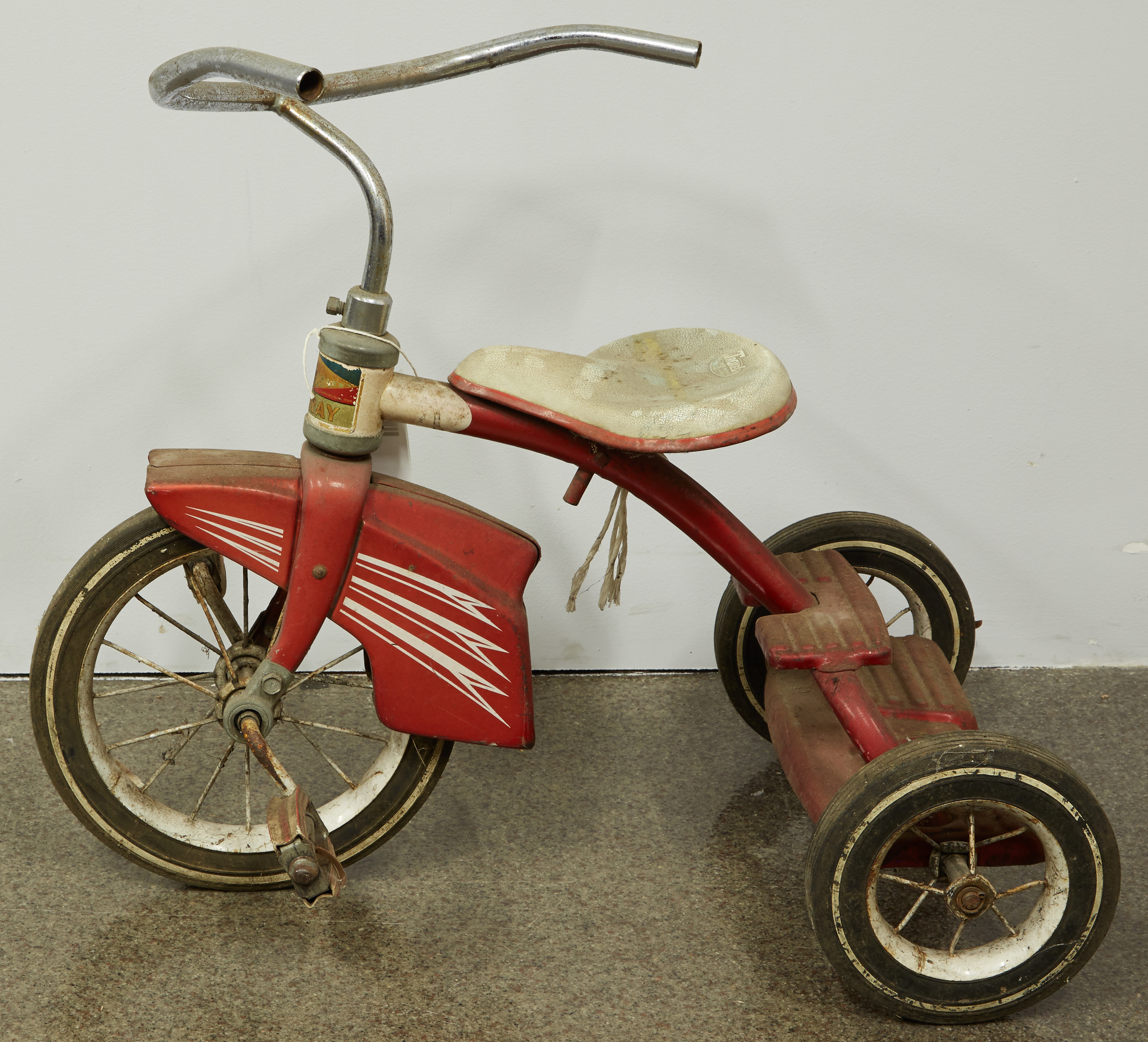 50 years of grime and corrosion are evident in this pre-treatment photo of the Murray tricycle.