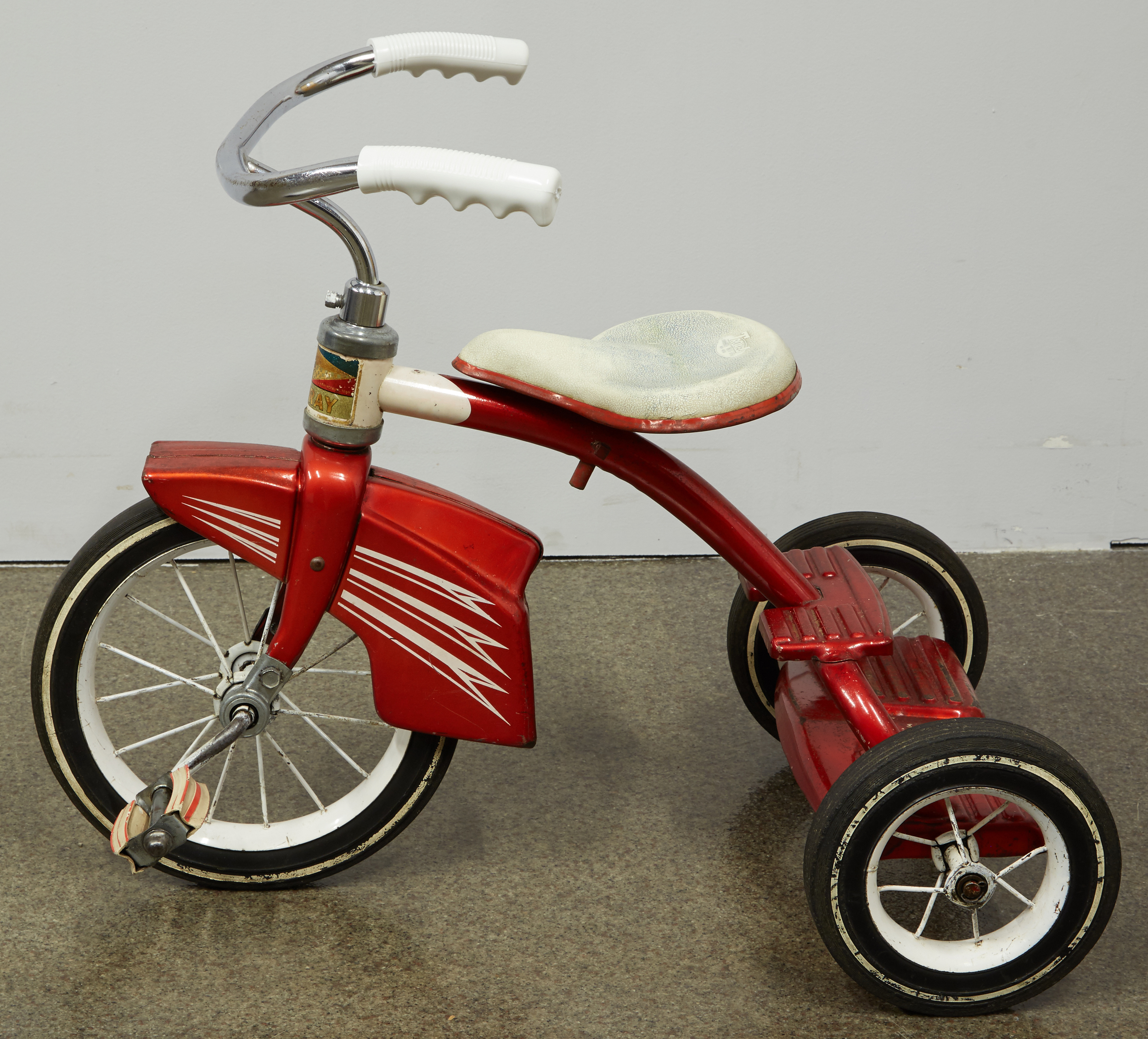 Post-treatment, the charm of Mary's 1964 Murray tricycle shines through.