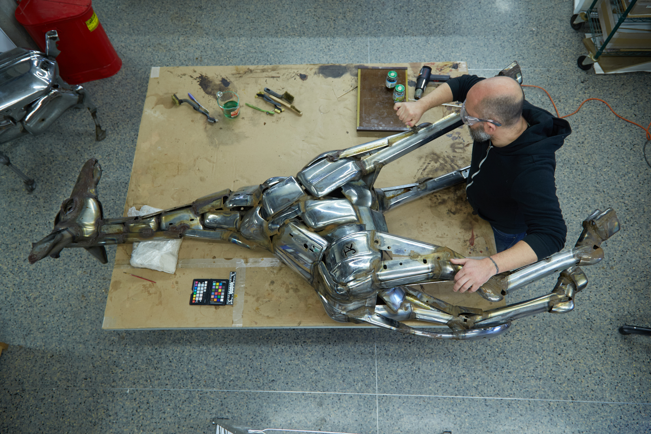 Giraffe  sculpture being treated by   Conservator, Andrew Rigsby  at The Center's laboratory.