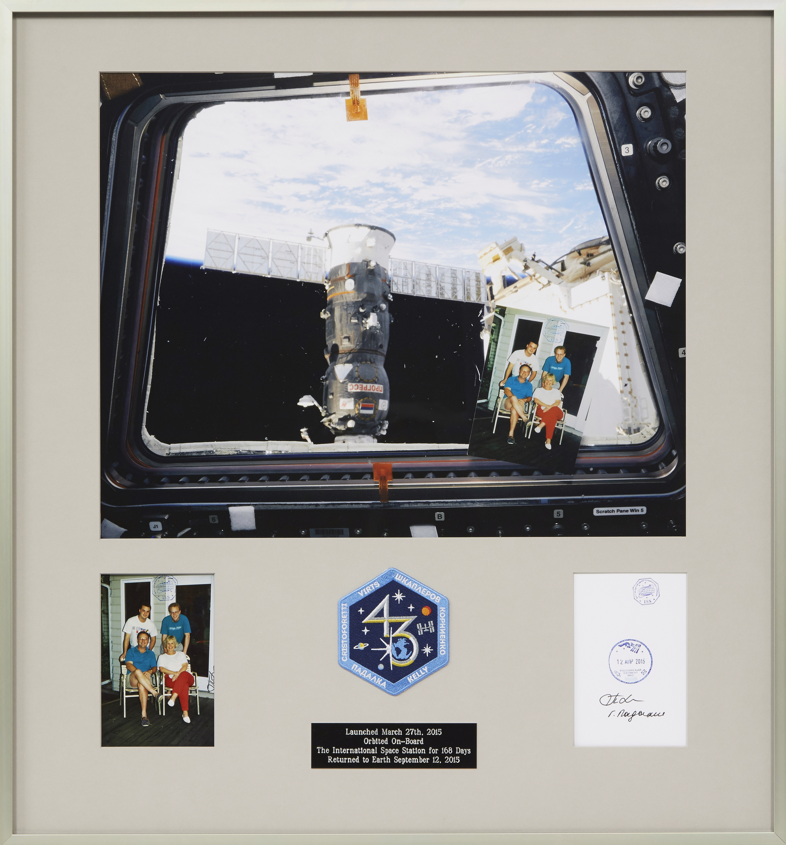 Finished project: Family photo displayed with the space memorabilia from the journey.