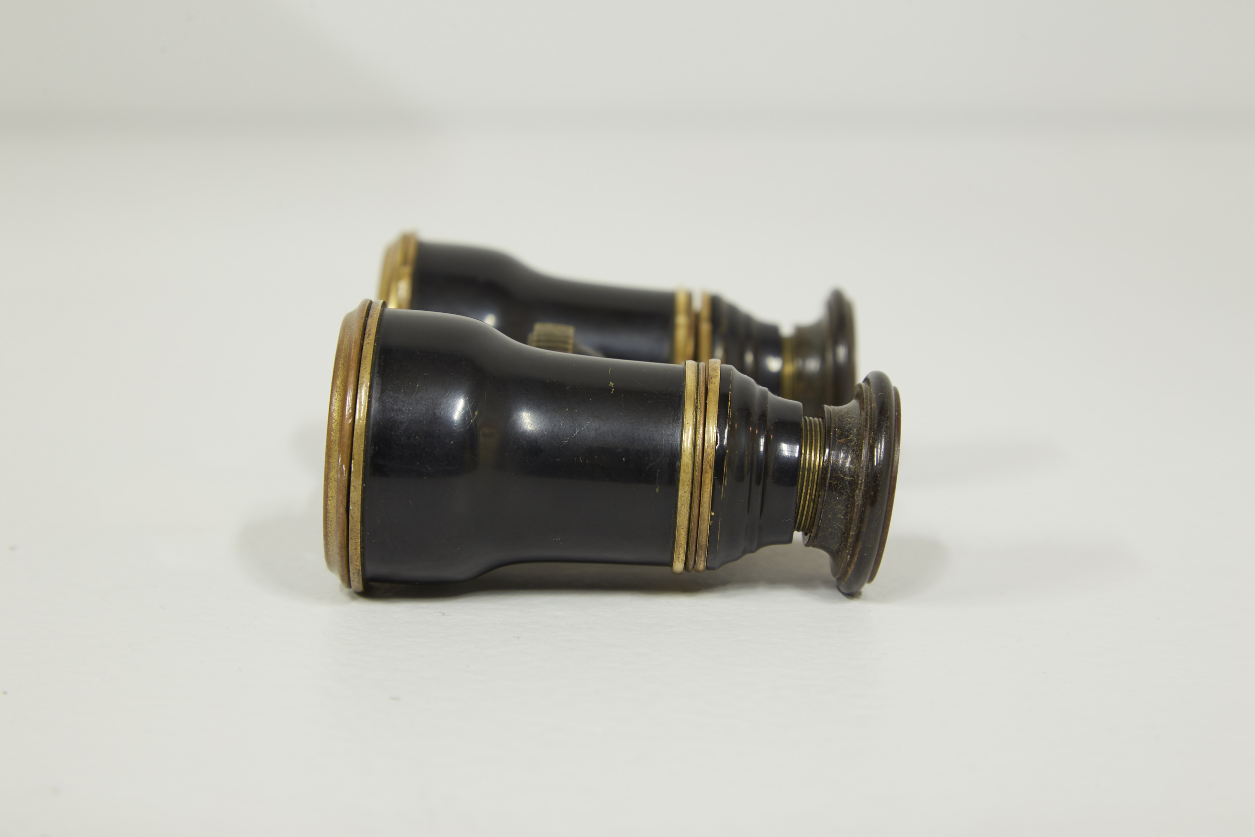 The opera glasses showing the tilted eyepiece, leaving hints the unique history accompanying the binoculars.  .