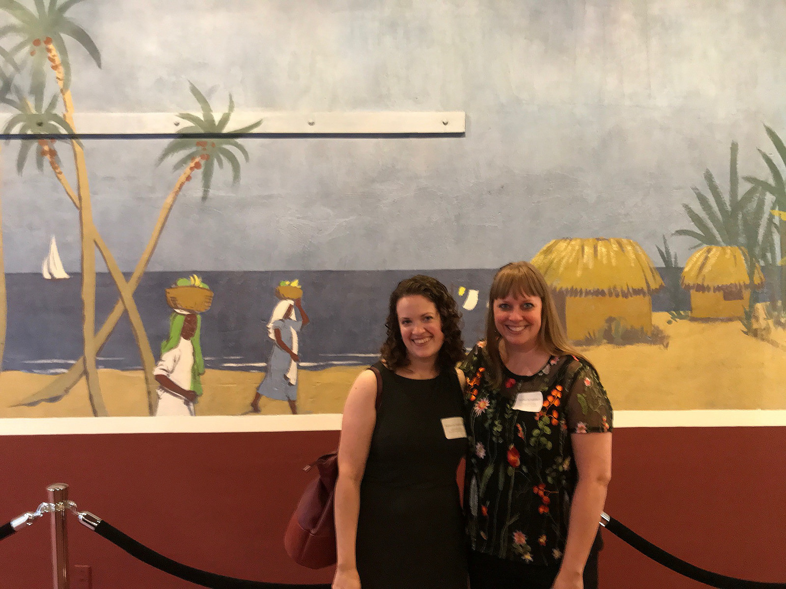 The Conservation Center's Painting Conservators, Rebecca Vodehnal and Amber Schabdach, in front of the finished west wall