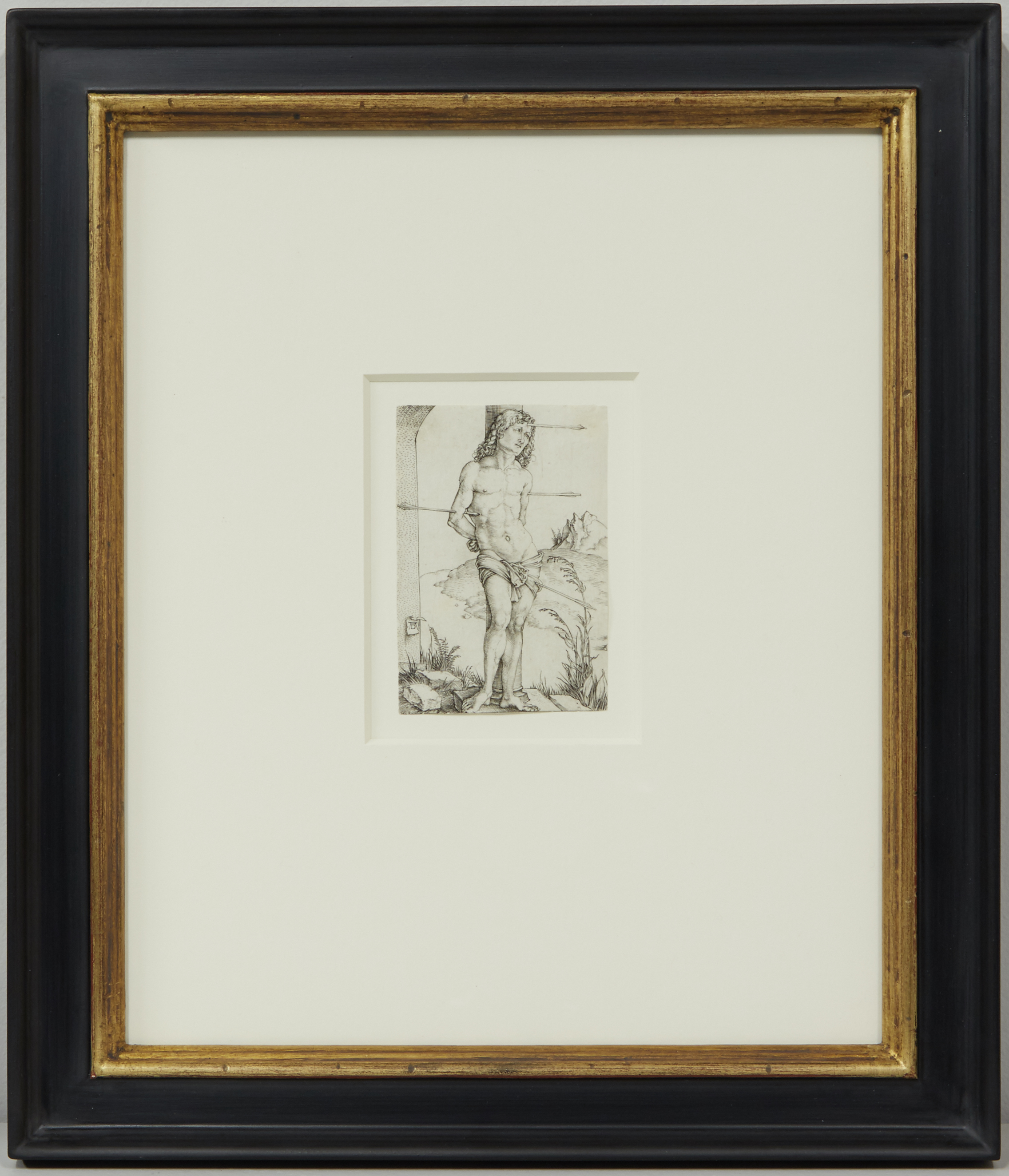 This piece by Albrecht Dürer was assembled with Conservation Clear glass, which protects against UV light rays, and was installed into a custom antique black profile frame with a gold lip.