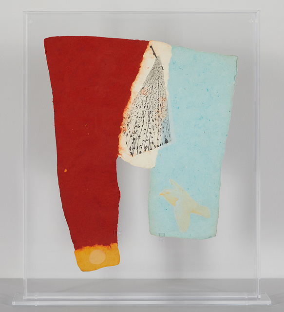 Rauschenberg intended pieces like this to be displayed in vitrines as 'specimens,' mimicking natural history displays. The original vitrine was cracked and yellowed. We replaced it with higher-grade UV-protective acrylic.