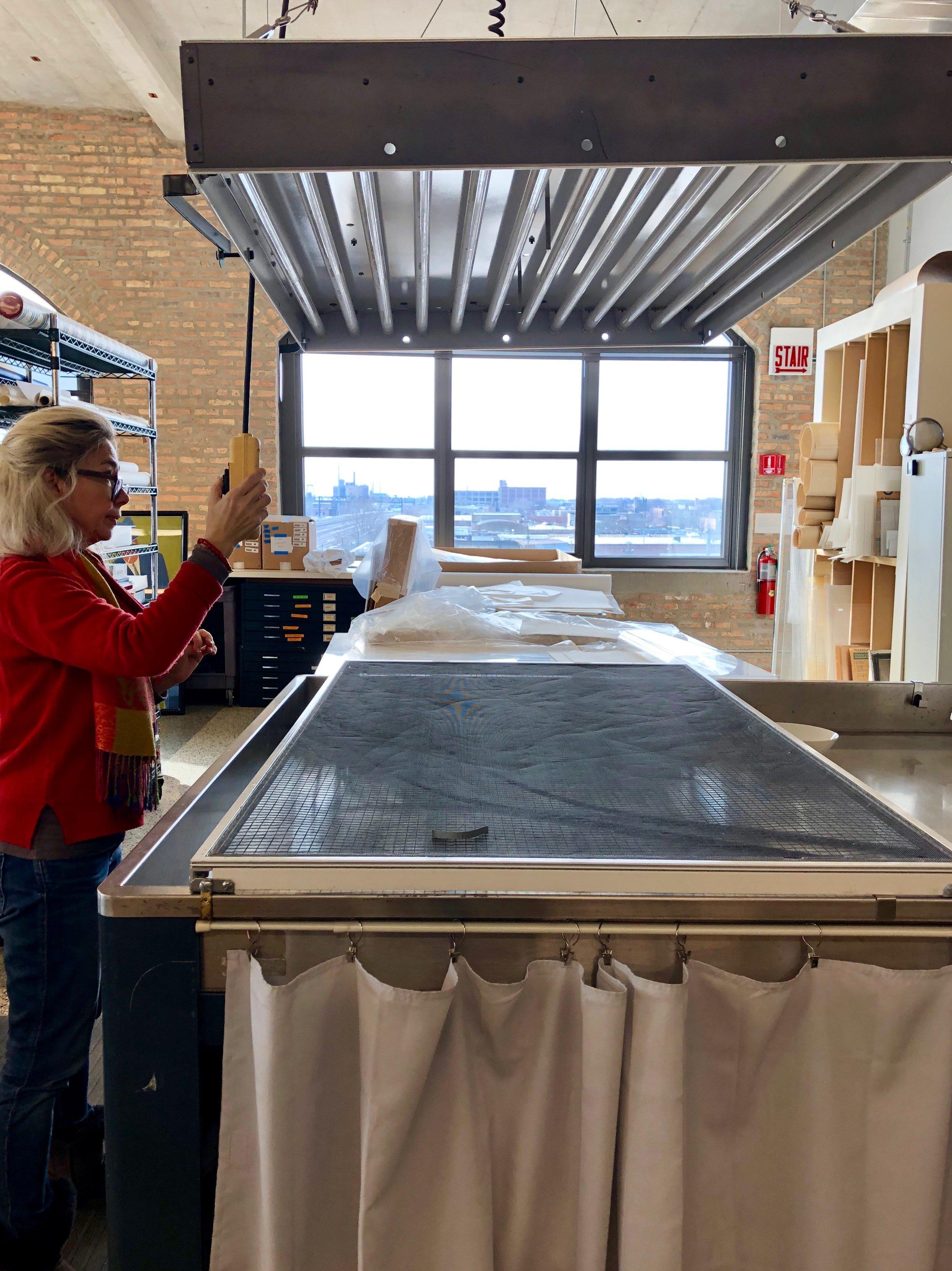 While the print soaks, Bozena prepares the light bleaching station.
