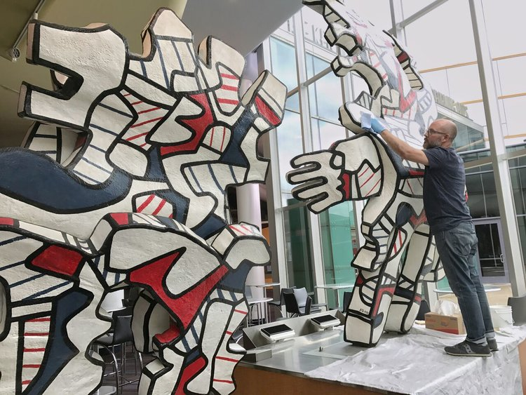 Conservators from The Center working on Dubuffet's  Faribolus and Perceval  at The Kentucky Center, 2017