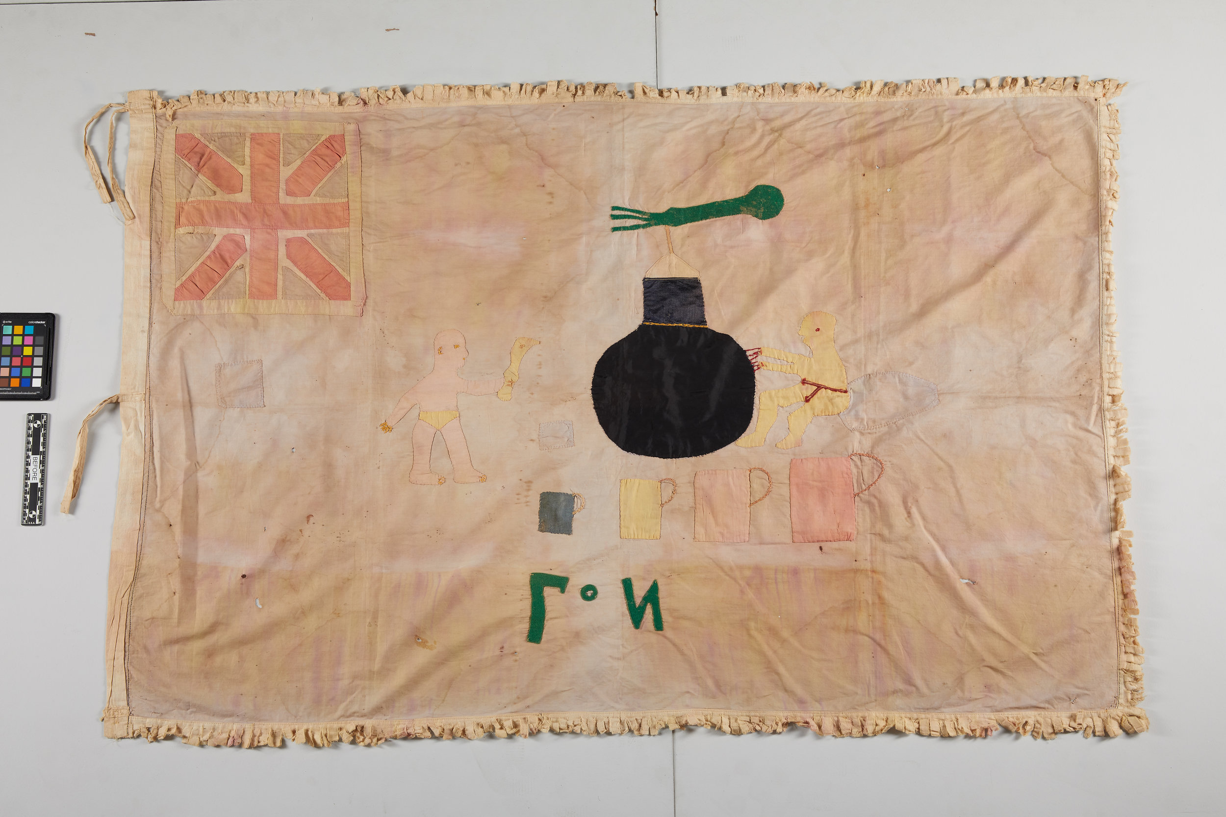 A stunning flag, with some fraying and dye stains, pre-treatment, 36 x 54.5 inches.
