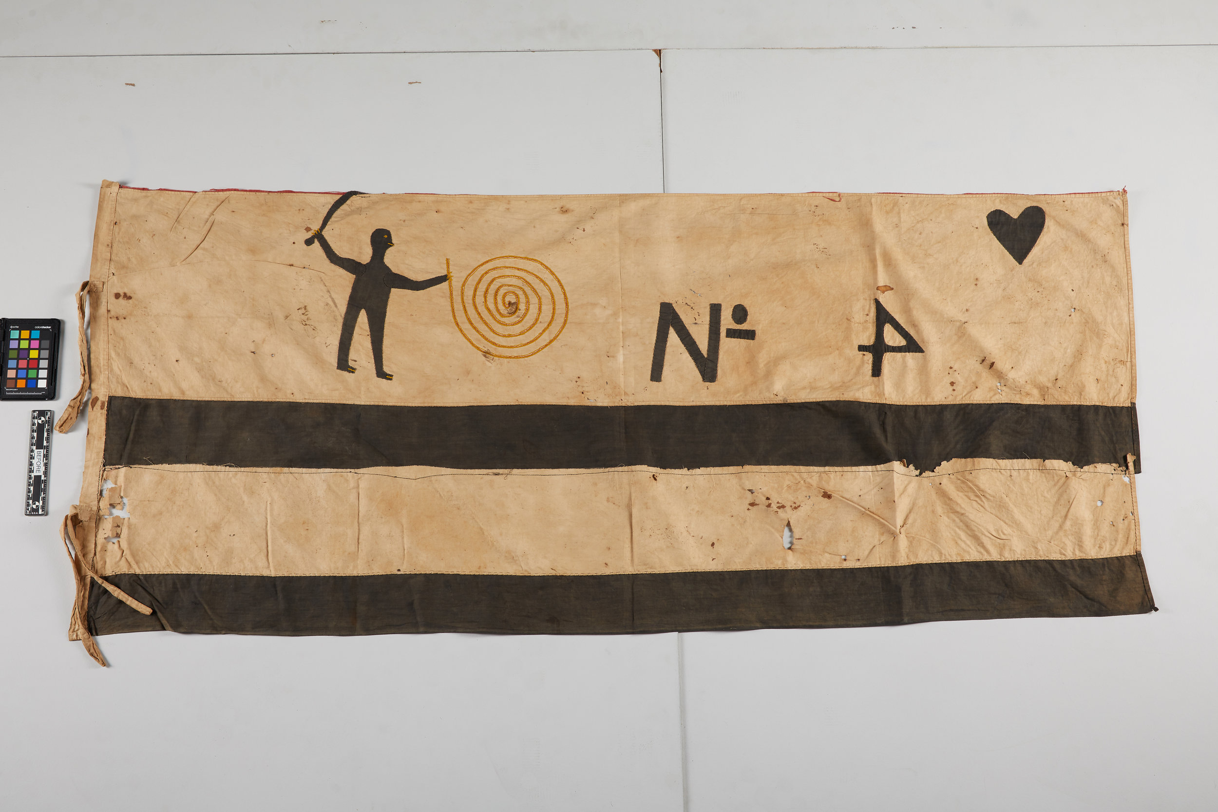 This flag features symbols and a human figure, along with bold horizontal stripes, 27.5 x 61.25 inches.