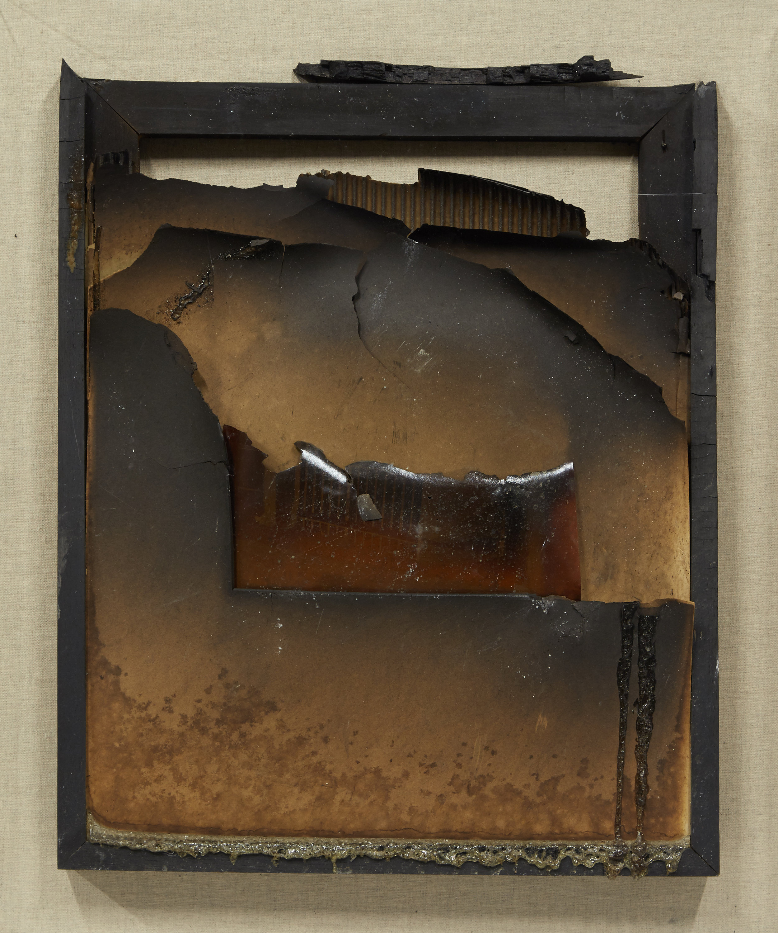 """A """"total loss,"""" a burned piece inside of a vitrine that was damaged during the LaSalle Bank Fire."""