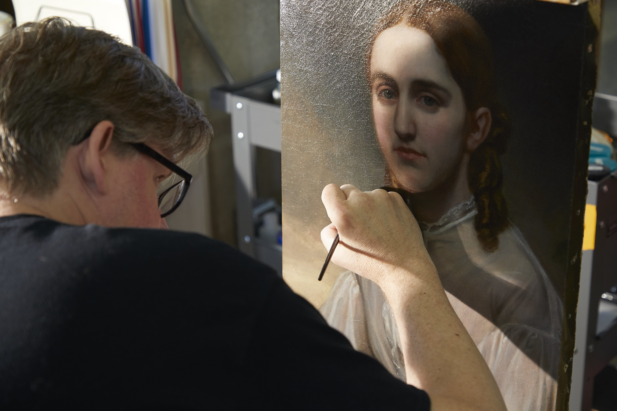 Michael, one of our painting conservators, working on the final details of the treatment.